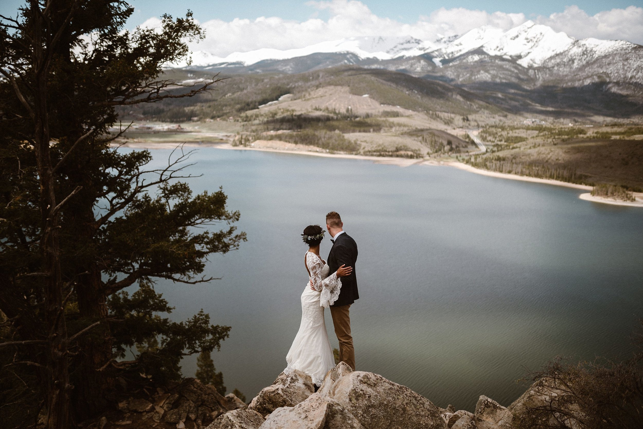 As though looking out on the endless possibilities for their future while stopped at Dillon reservoir, this vintage inspired couple were the only people around for miles. Their inspiring love and intimate elopement captured by Maddie Mae Photography.