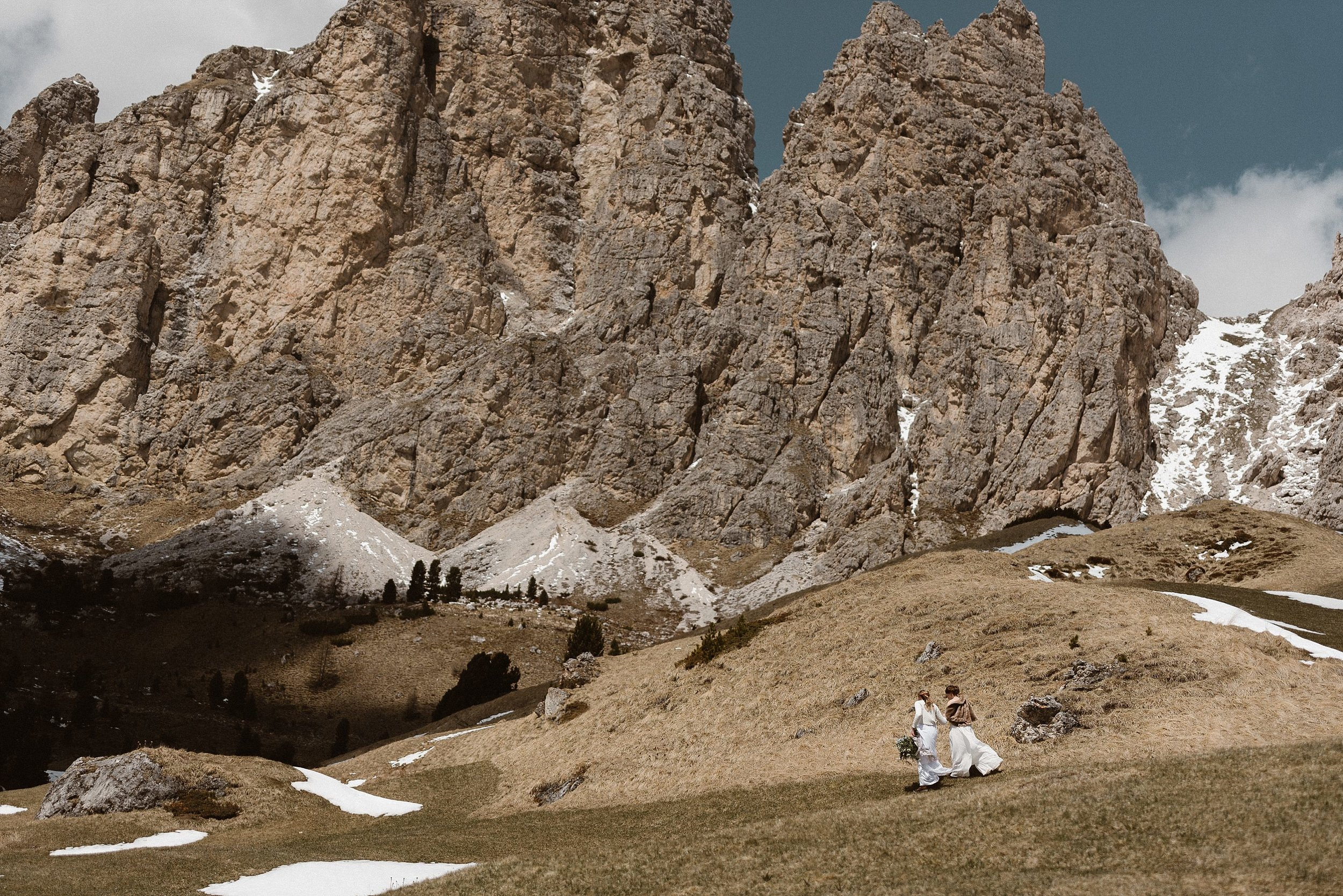 There are few things as simply sweet as a long and loving embrace surrounded by snow and jagged rocks in the Italian Dolomite mountains where these brides picked for their intimate elopement ceremony. Photos by traveling wedding photographer Maddie Mae.