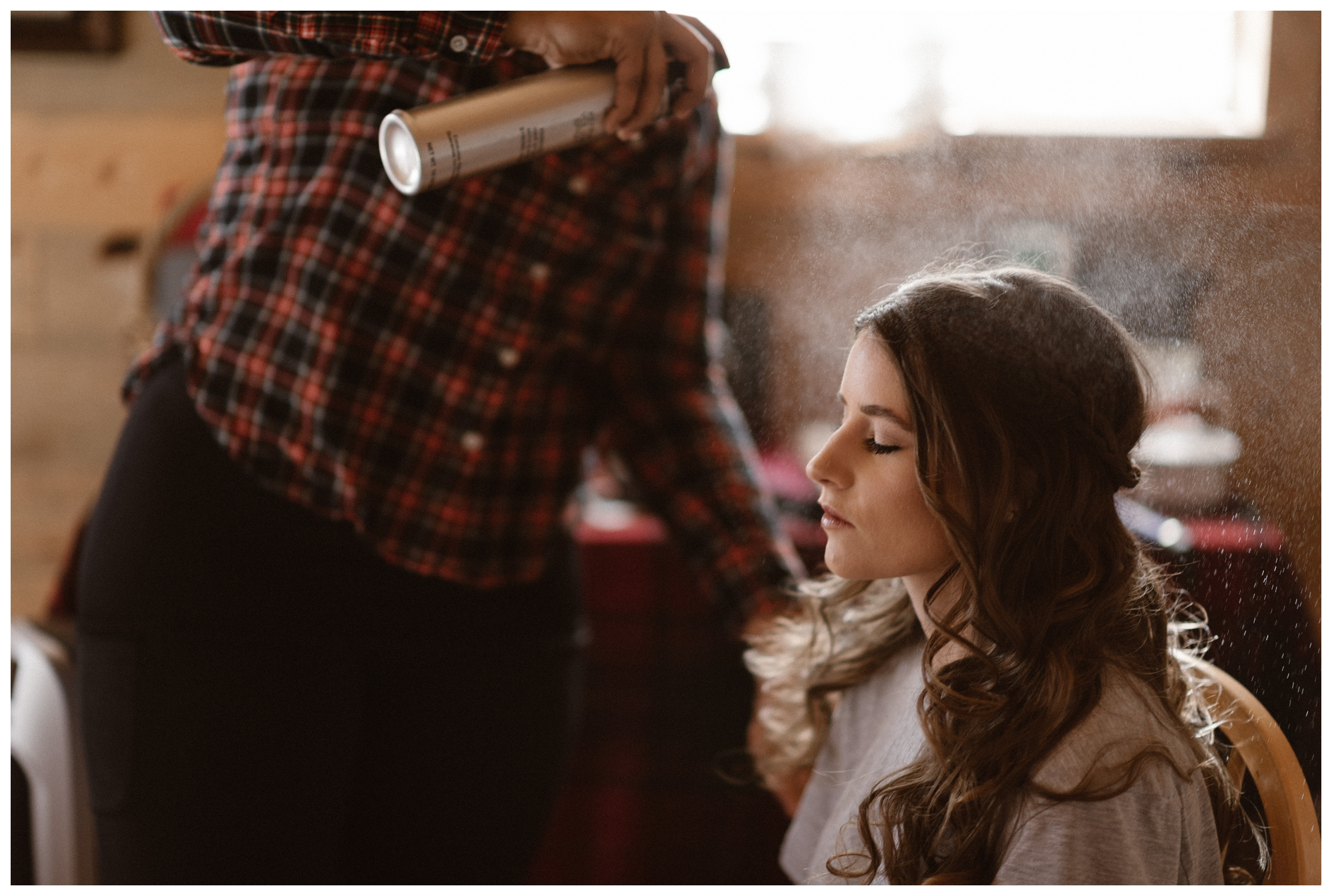Olivia getting her hair done and getting ready for her winter elopement ceremony. Photo by Maddie Mae Photo, Adventures Instead.