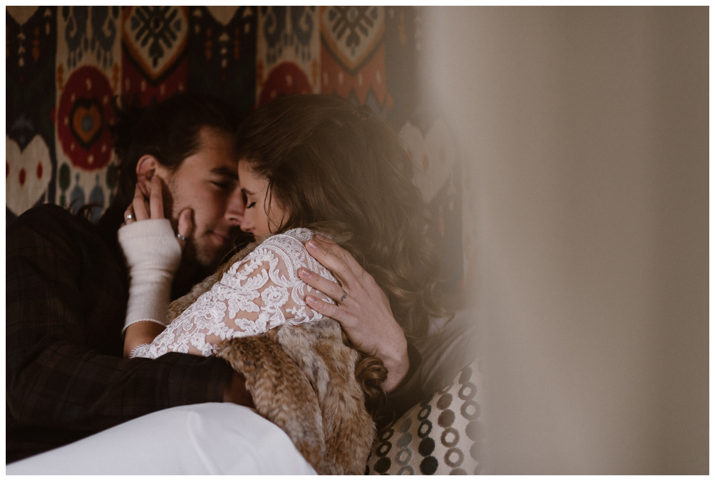 Olivia and Justin cuddle in their refurbished trailer before their winter wedding outside Southern Colorado. Photo by Maddie Mae Photo, Adventures Instead.