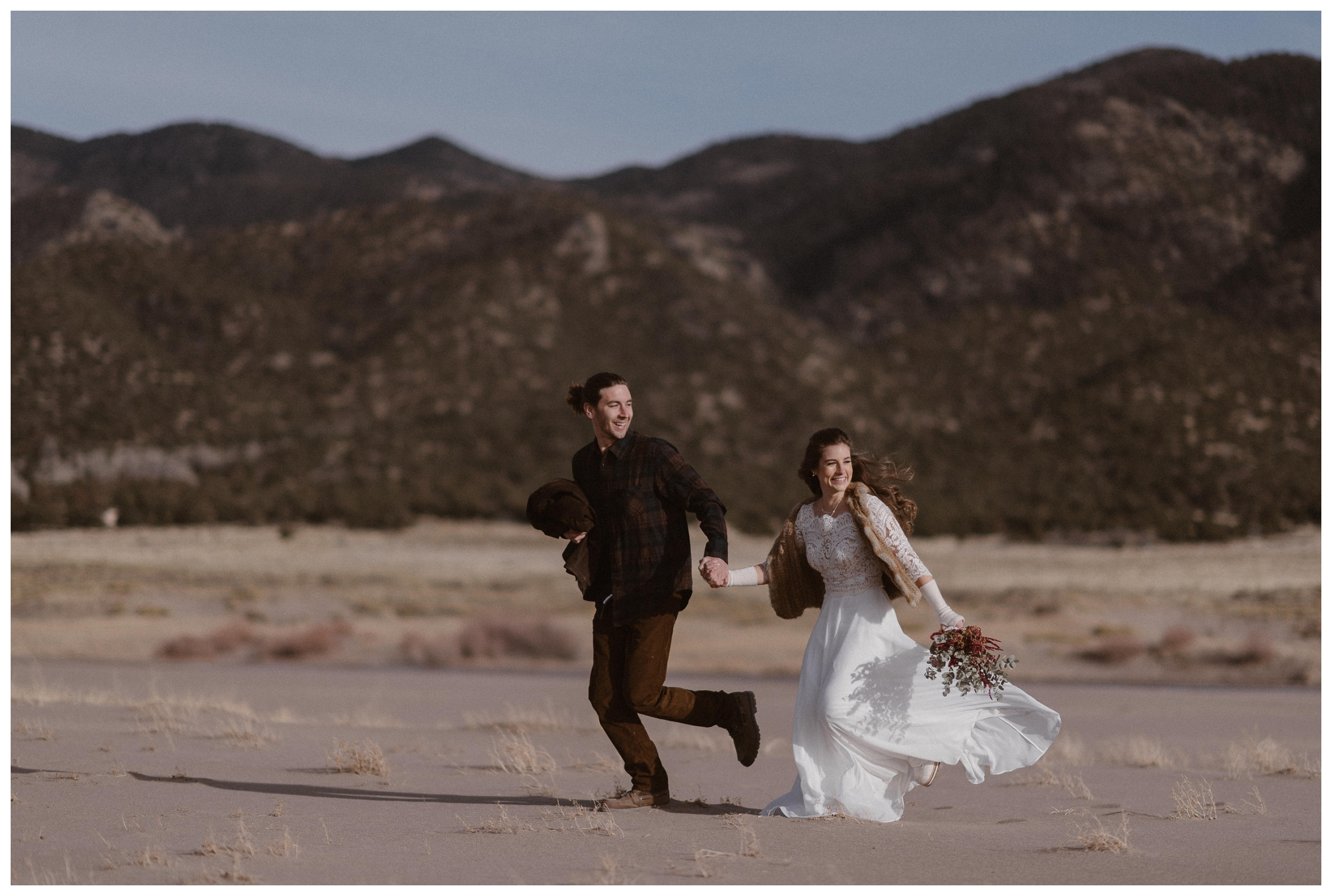 Olivia and Justin run through the Great Sand Dunes National Park for their winter adventure elopement.