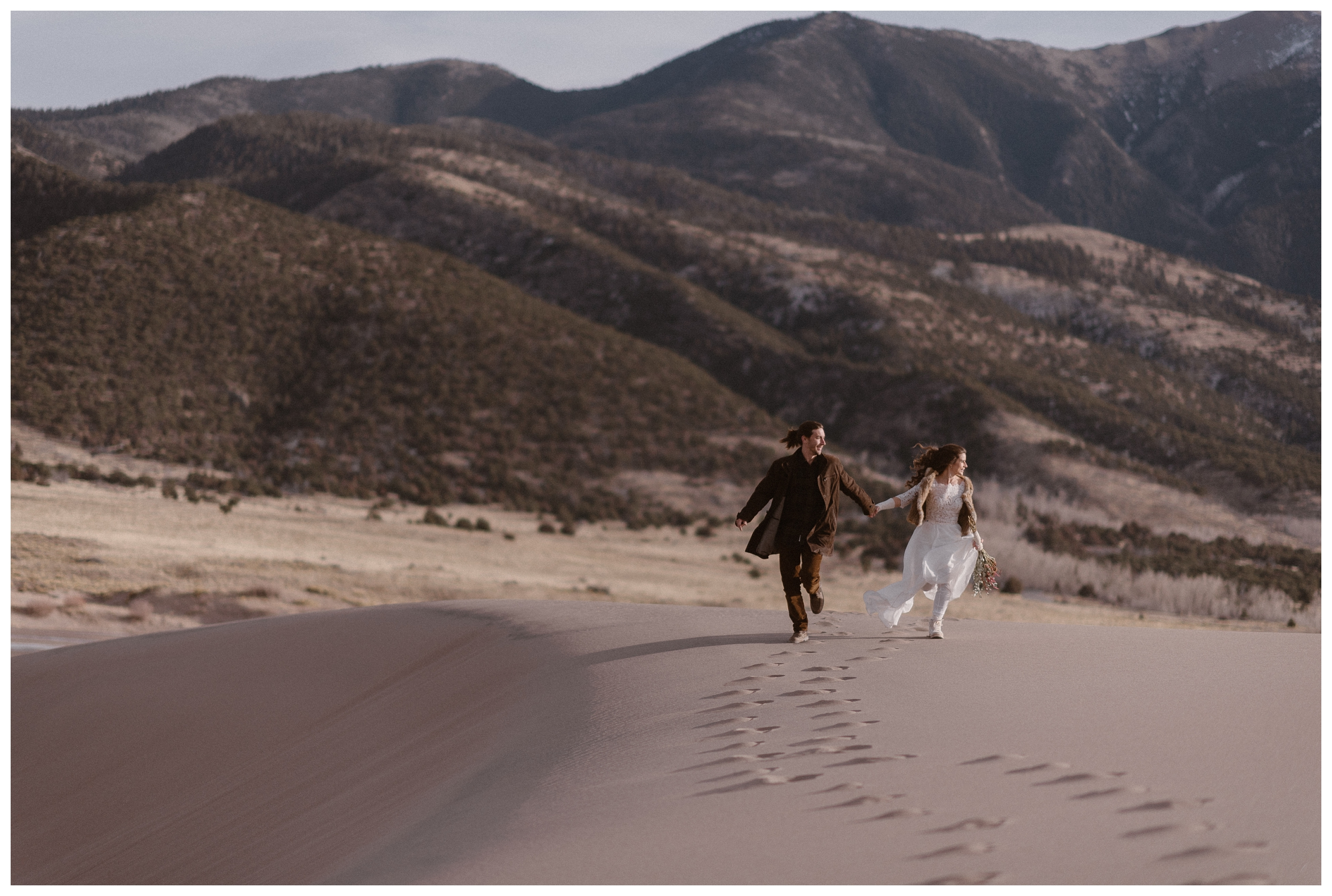 Olivia and Justin explore Great Sand Dunes National Park together before their winter elopement. Photo by Maddie Mae Photo, Adventures Instead.