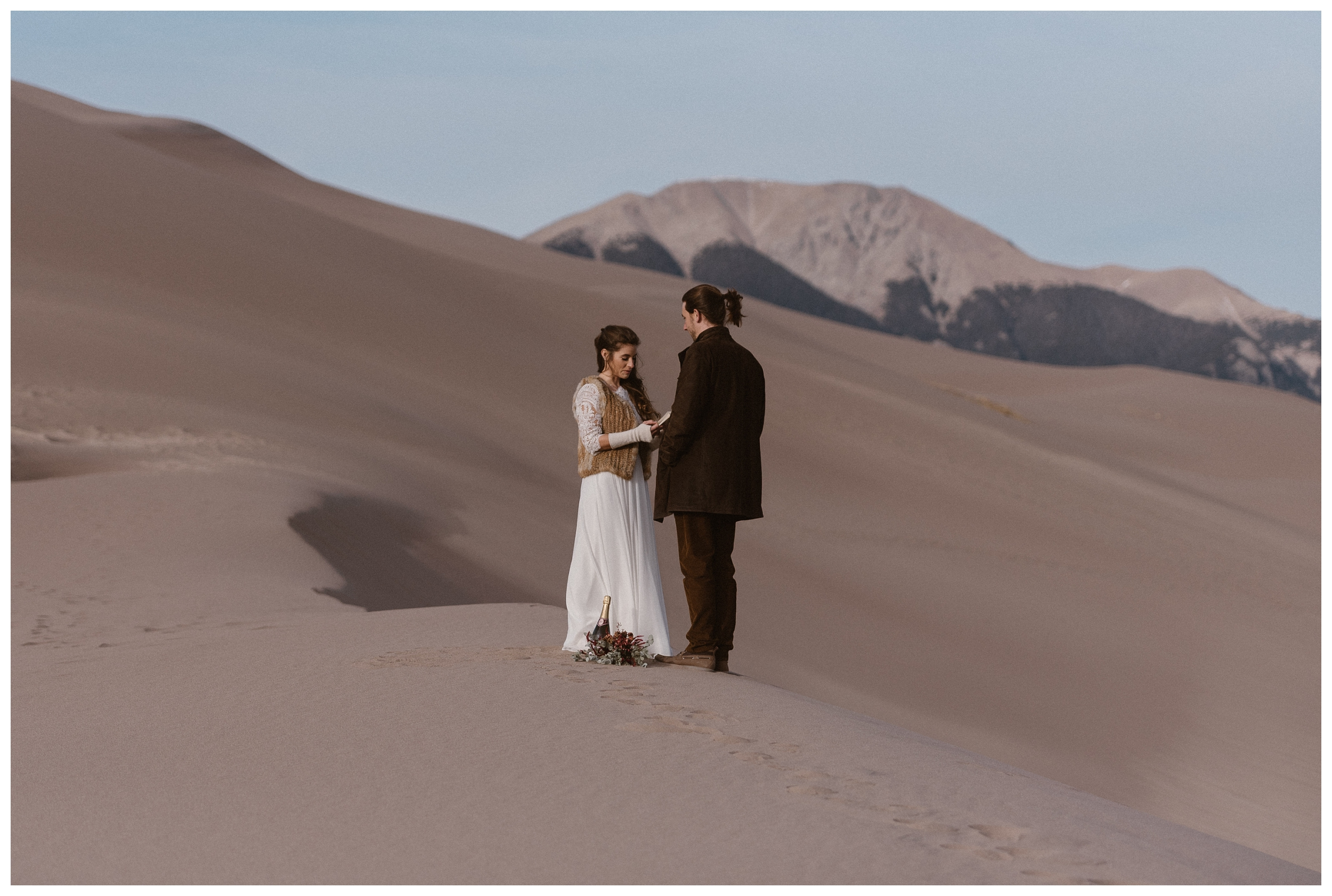 Olivia and Justin have a self solemnizing ceremony for their wilderness elopement at Great Sand Dunes National Park. Photo by Maddie Mae Photo, Adventures Instead.