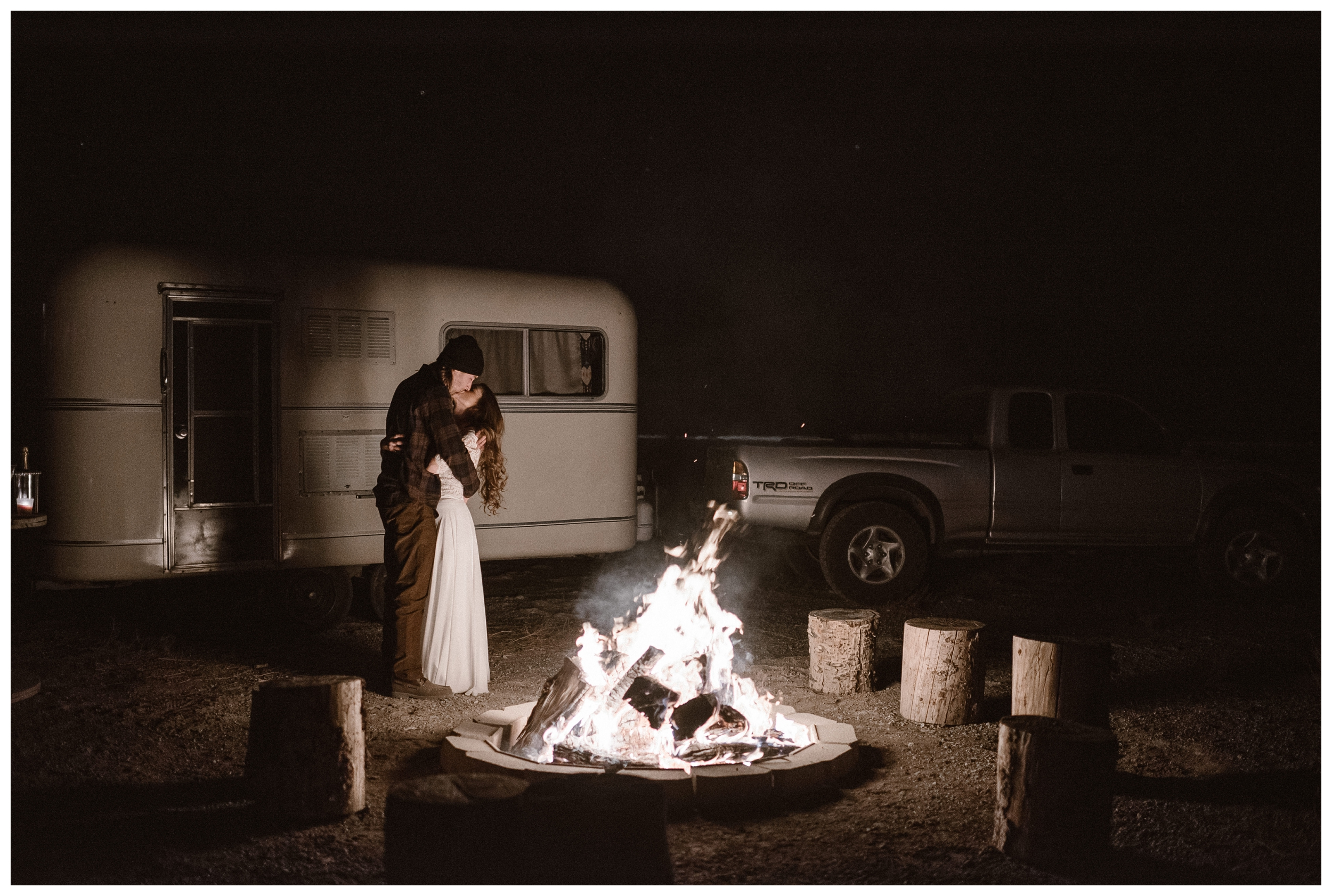 Newlywed couple has their first dance outside their refurbished trailer after their intimate outdoor elopement in Southern Colorado. Photo by Maddie Mae Photo, Adventures Instead.
