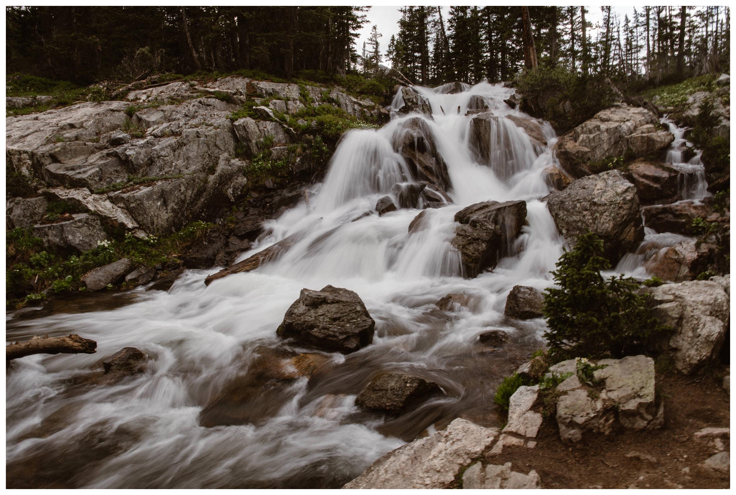 Spring snow runoff makes for an epic waterfall as it flows down from Gem Lake outside Estes Park in Colorado. Photo by Maddie Mae Photo, Adventure Instead.
