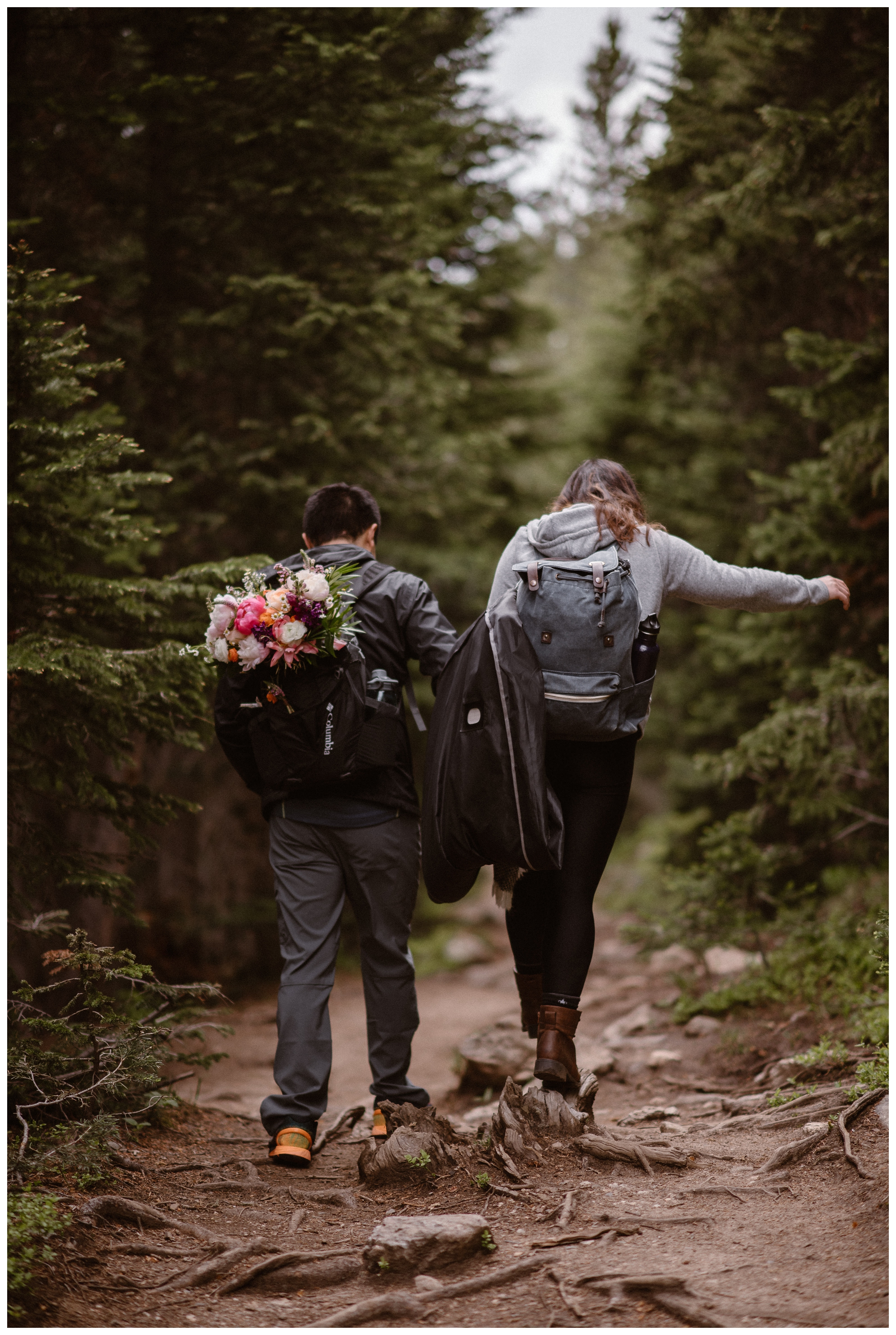 Leslie and Jinson continue to hike up the trail towards high alpine lake Gem Lake in Colorado's Rocky Mountain for their elopement ceremony. Photo by Maddie Mae Photo, Adventure Instead.