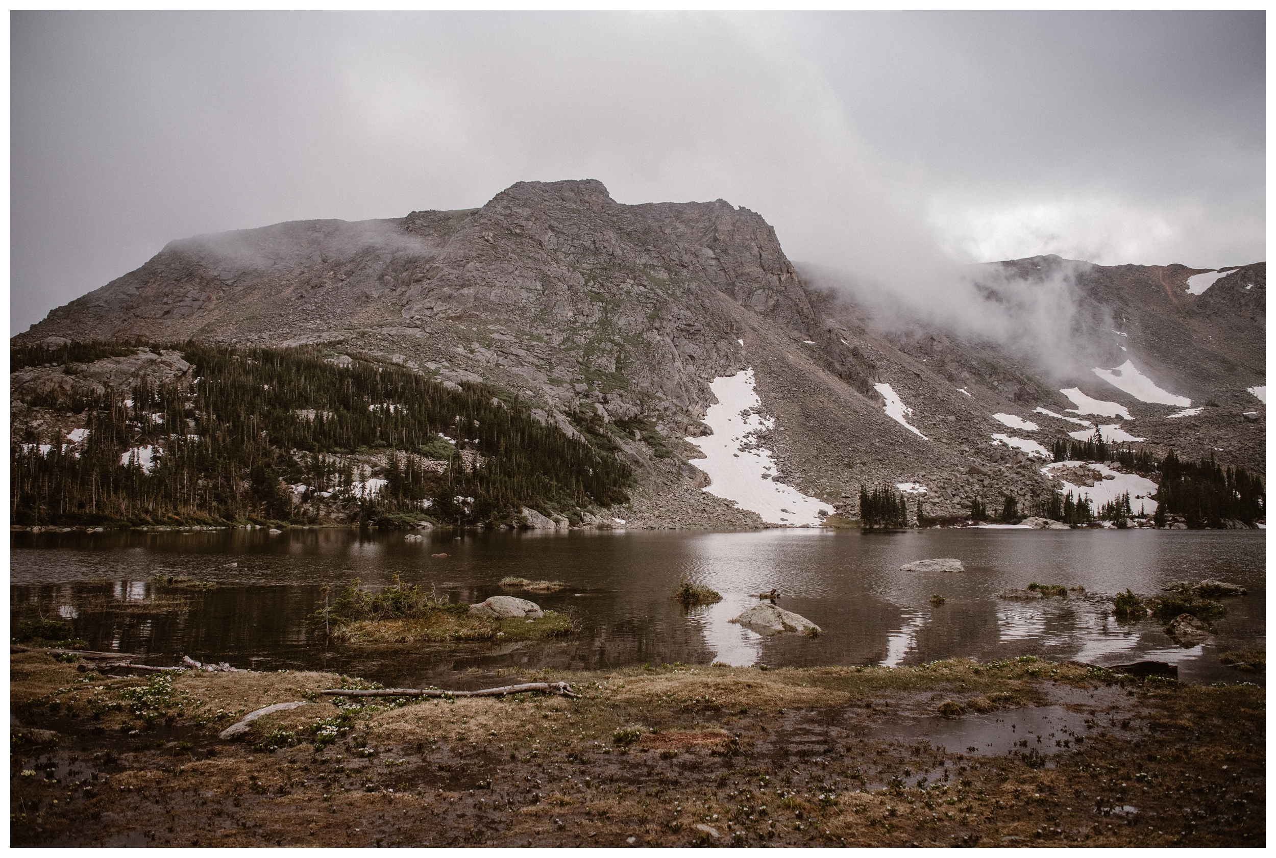 Cloud inversion rolls over the Rocky Mountains at Gem Lake outside Estes Park, Colorado for a high mountain alpine lake elopement. Photo by Maddie Mae Photo, Adventure Instead.