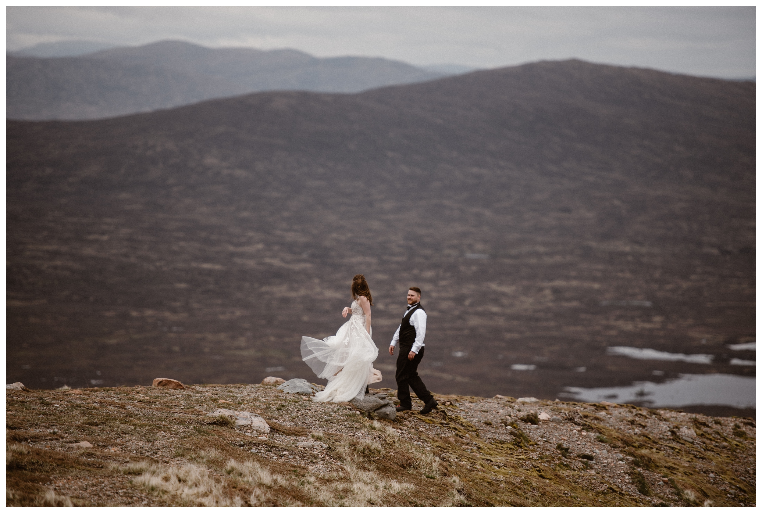With the fog of early May in Scotland rolling around the hills behind them, Elissa and Daniel twirl in the Scottish Highlands. Photo by Maddie Mae, Adventure Instead.