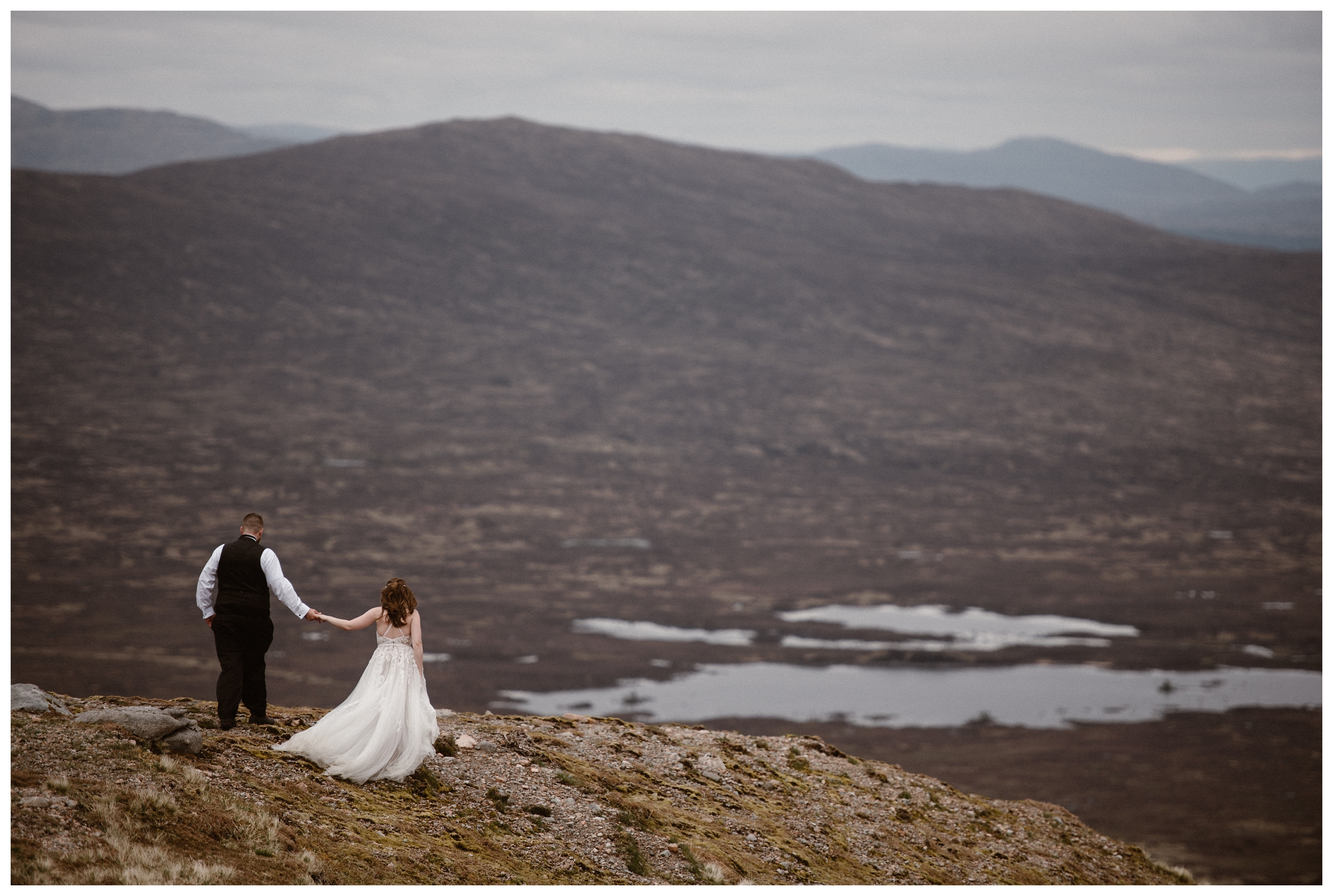 Elissa and Daniel walk through the marsh and bog of the Scottish Highlands outside Glencoe Scotland as they search for the perfect site for their destination elopement. Photo by Maddie Mae, Adventure Instead.