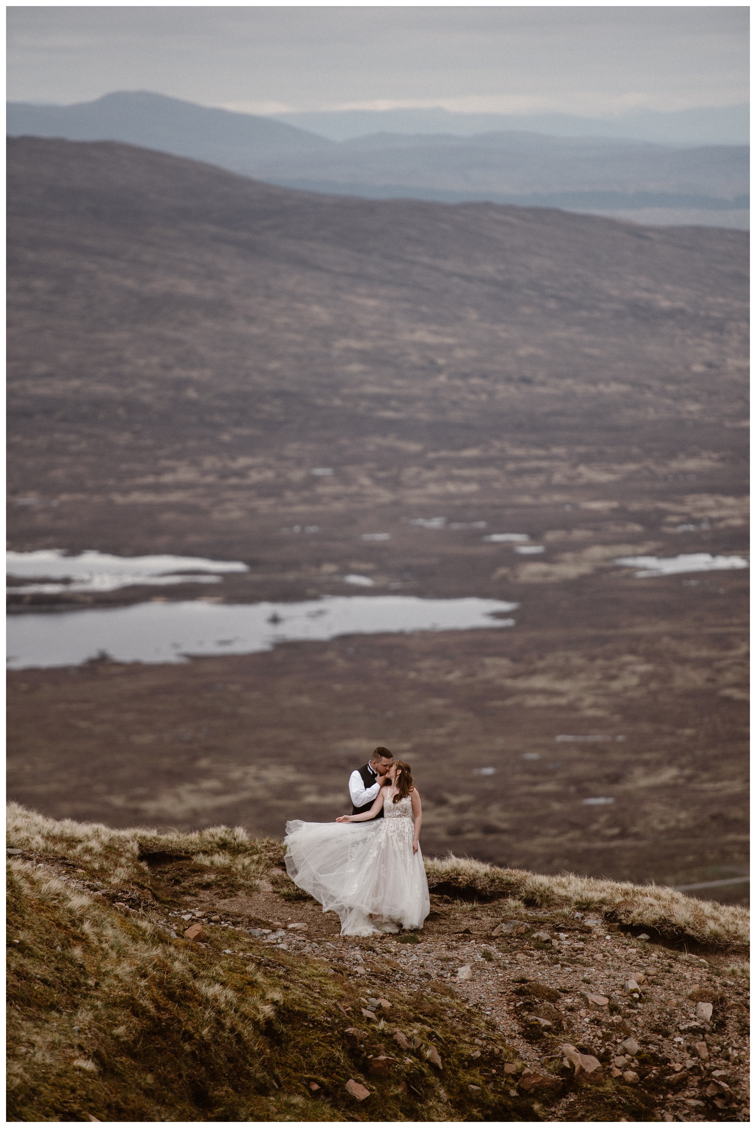 With the mountains of the Scottish Highlands behind them, Elissa and Daniel embrace ahead of their destination elopement. Photo by Maddie Mae, Adventure Instead.