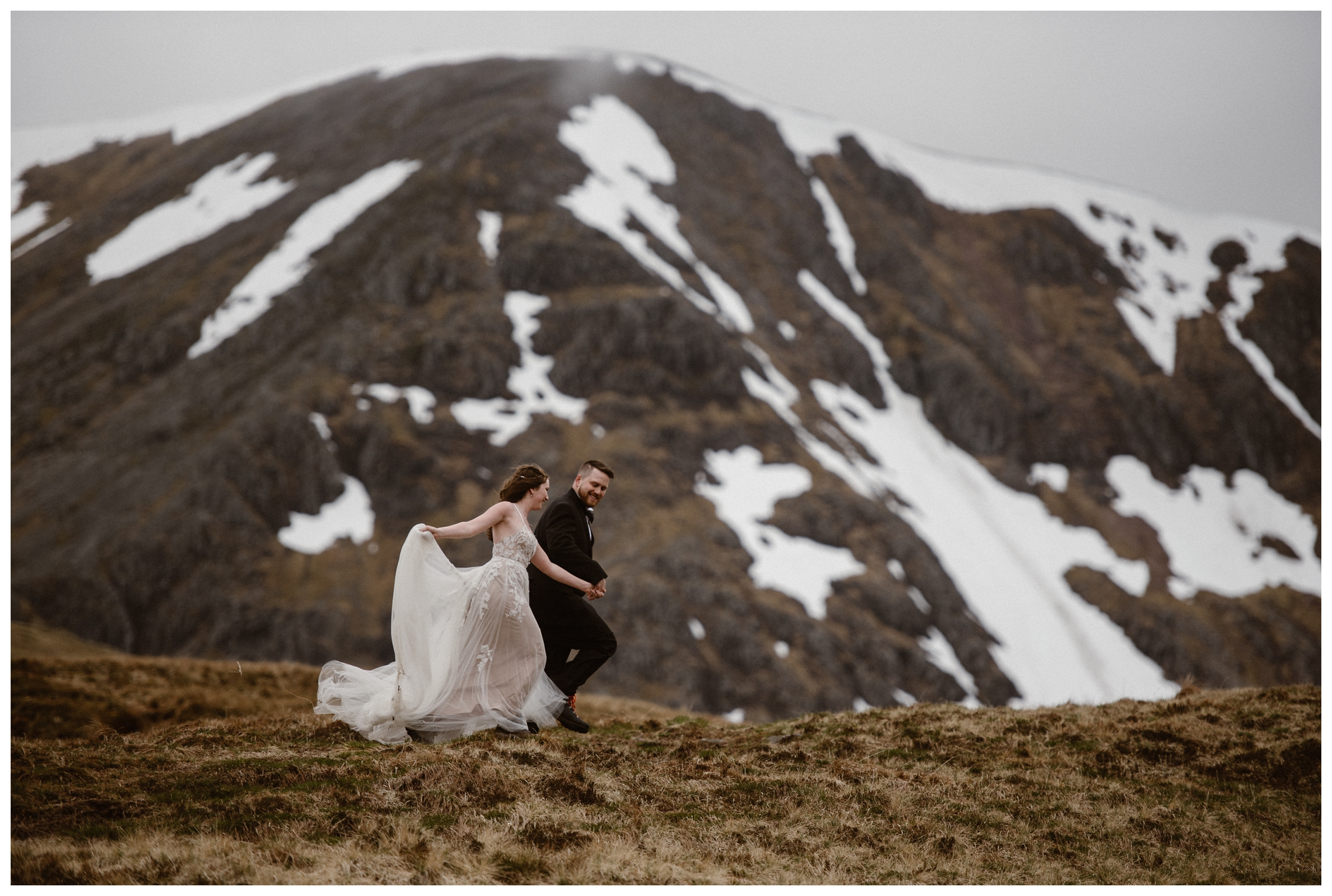The mountains in the Scottish Highlands still had little patches of snow on them during Elissa and Daniel's adventure destination elopement. Photo by Maddie Mae, Adventure Instead.