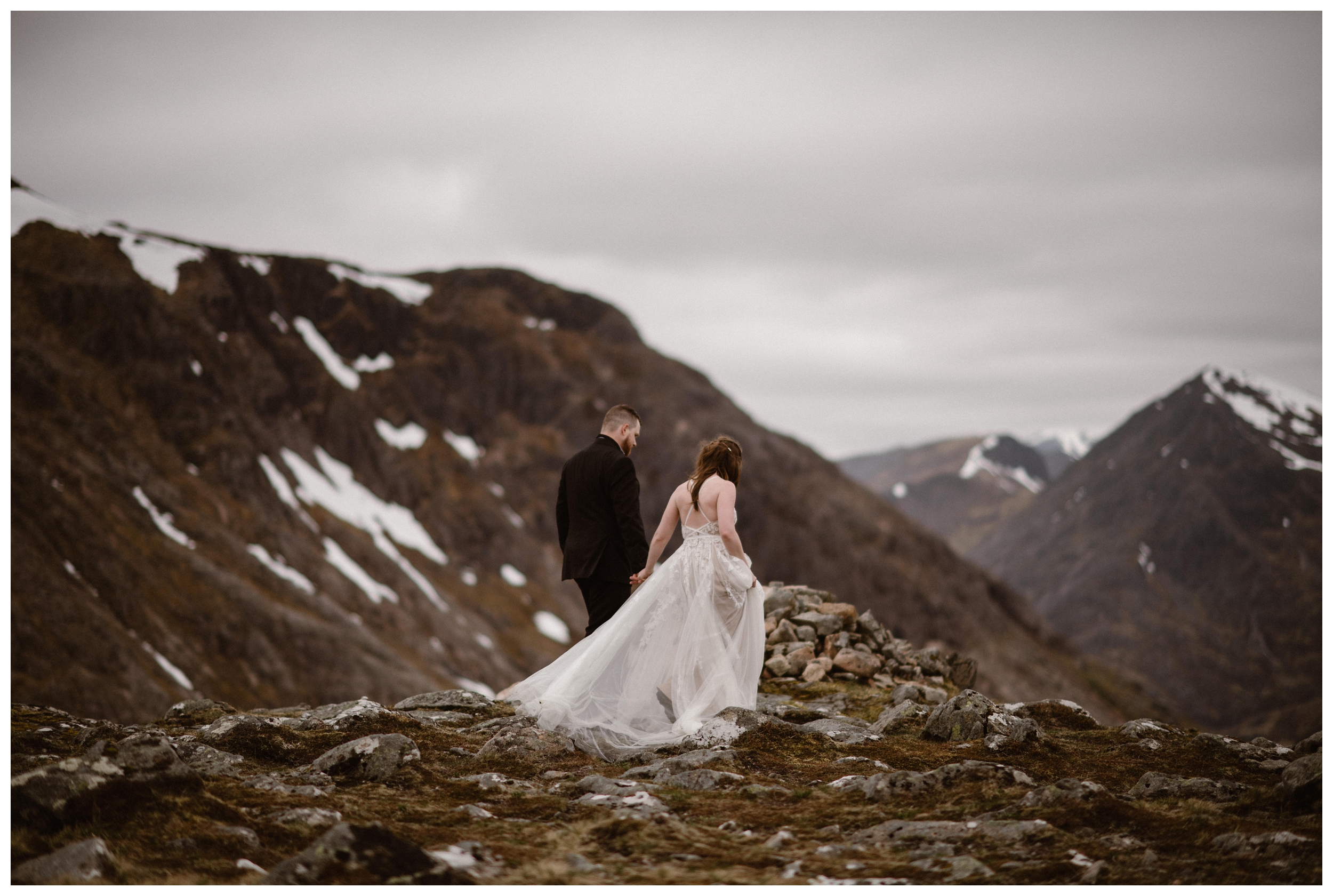 Patches of snow dot the Scottish Highland hills, which were empty of people during Elissa and Daniel's destination elopement ceremony. Photo by Maddie Mae, Adventure Instead.