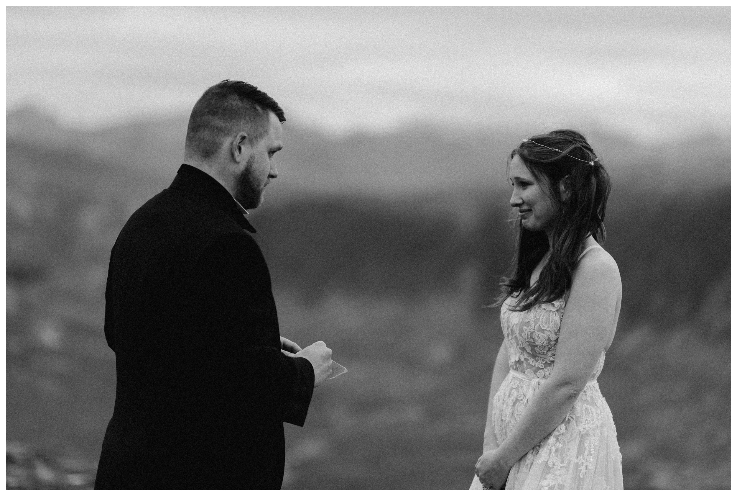 Daniel reads his marriage vows to Elissa during their private self solemnizing adventure destination elopement in the Scottish Highlands. Photo by Maddie Mae, Adventure Instead.