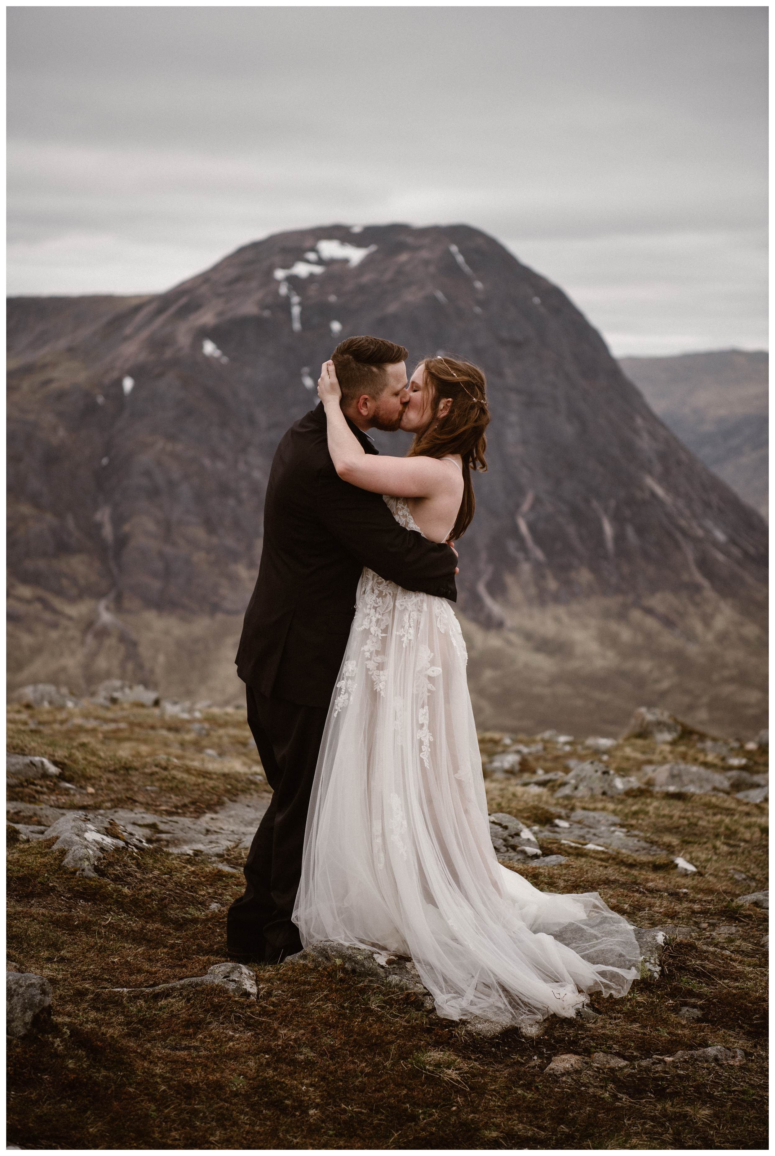 Elissa and Daniel share their first kiss after their self solemnizing elopement ceremony in the Scottish Highlands. Photo by Maddie Mae, Adventure Instead.