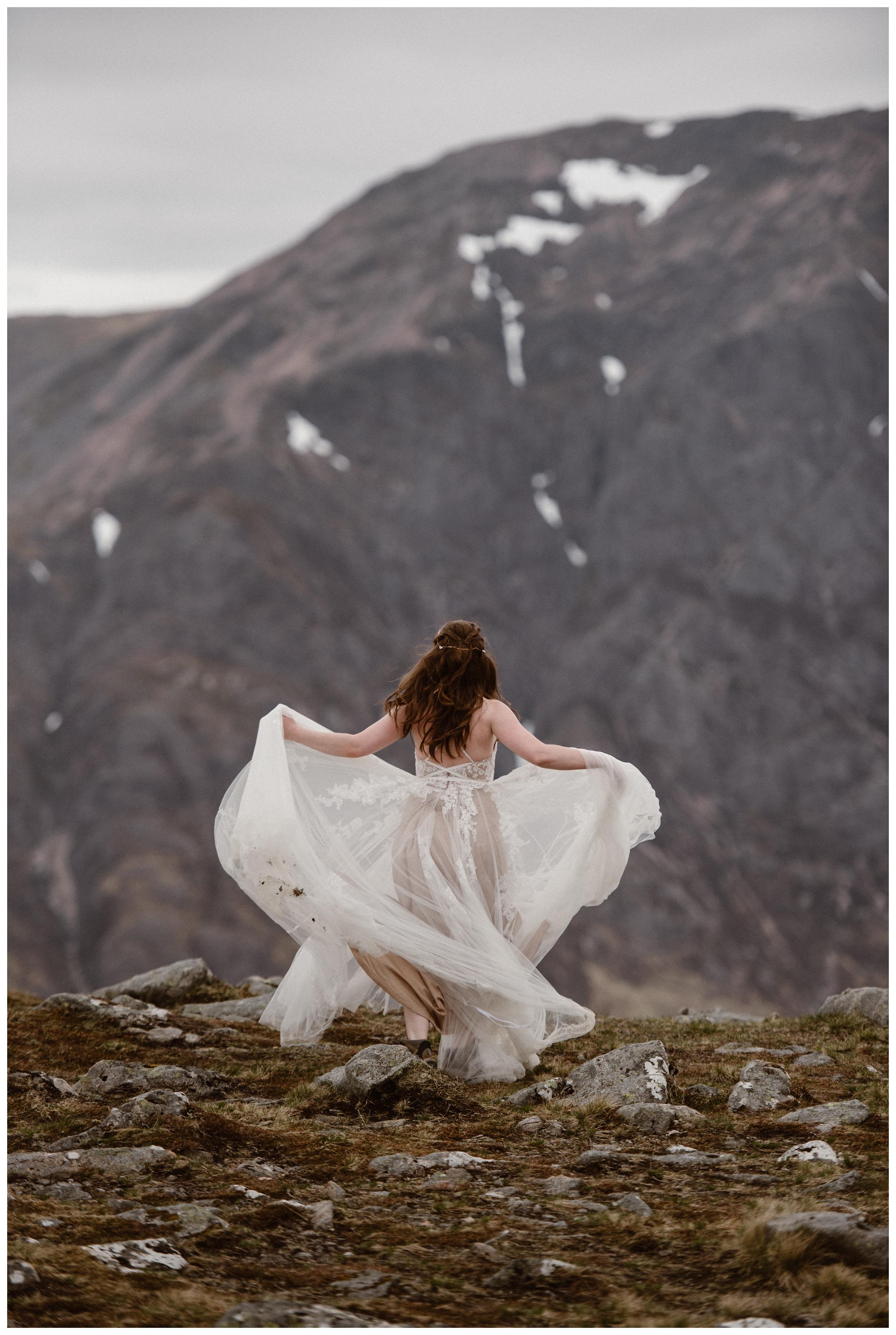 Elissa twirls her dress in the Scottish Highlands following her destination elopement. Photo by Maddie Mae, Adventure Instead.