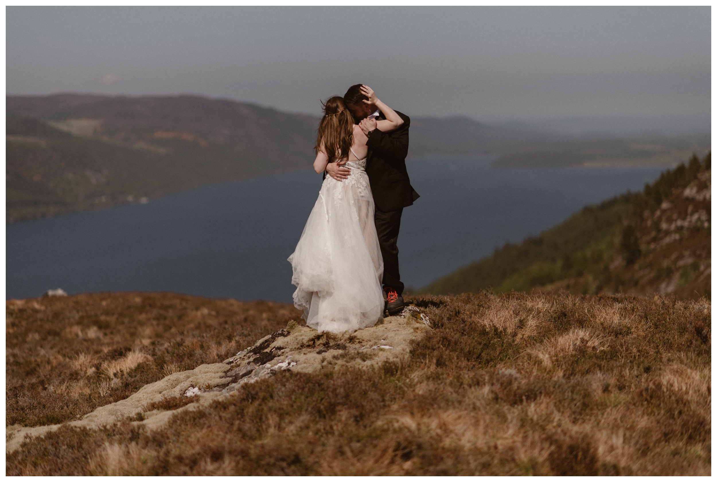 Elissa and Daniel embrace on the north shore of Loch Ness in the Scottish Highlands following their elopement in Glencoe, Scotland the day before. Photo by Maddie Mae, Adventure Instead.