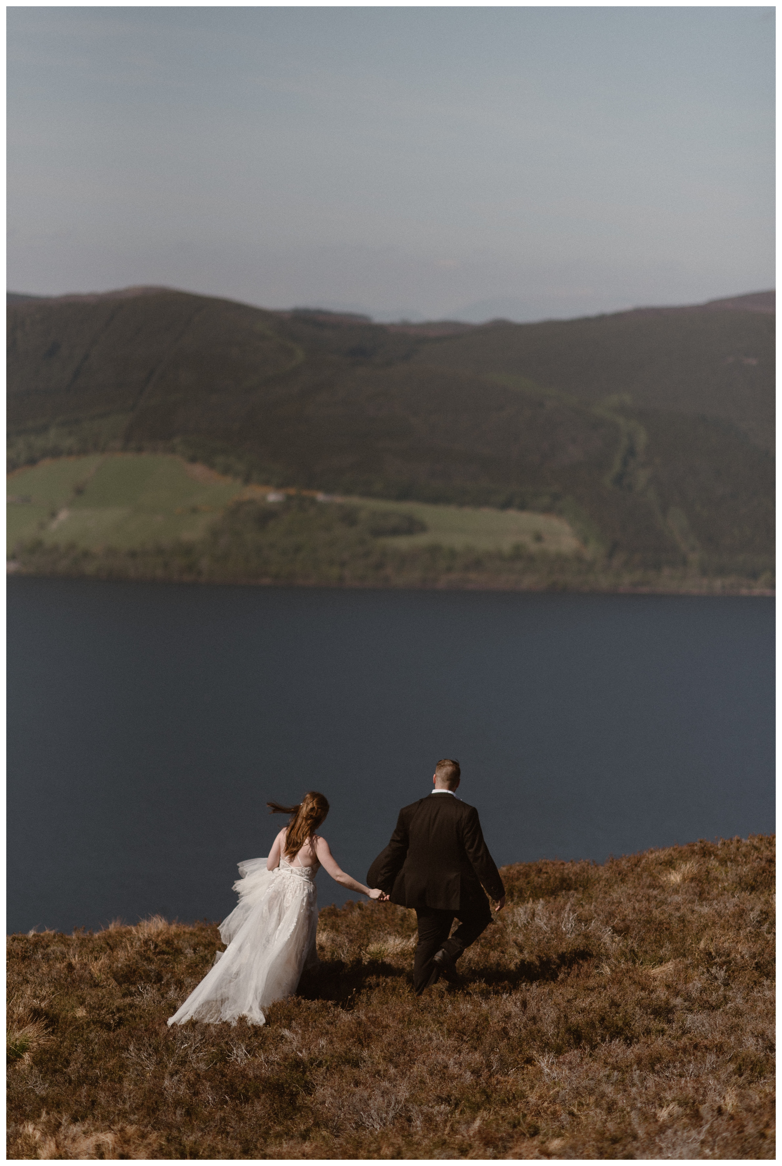 As we explored the north shores of Loch Ness in the Scottish Highlands following Elissa and Daniel's destination elopement, we could see Urquhart Castle and where the loch empties towards the North Sea. Photo by Maddie Mae, Adventure Instead.