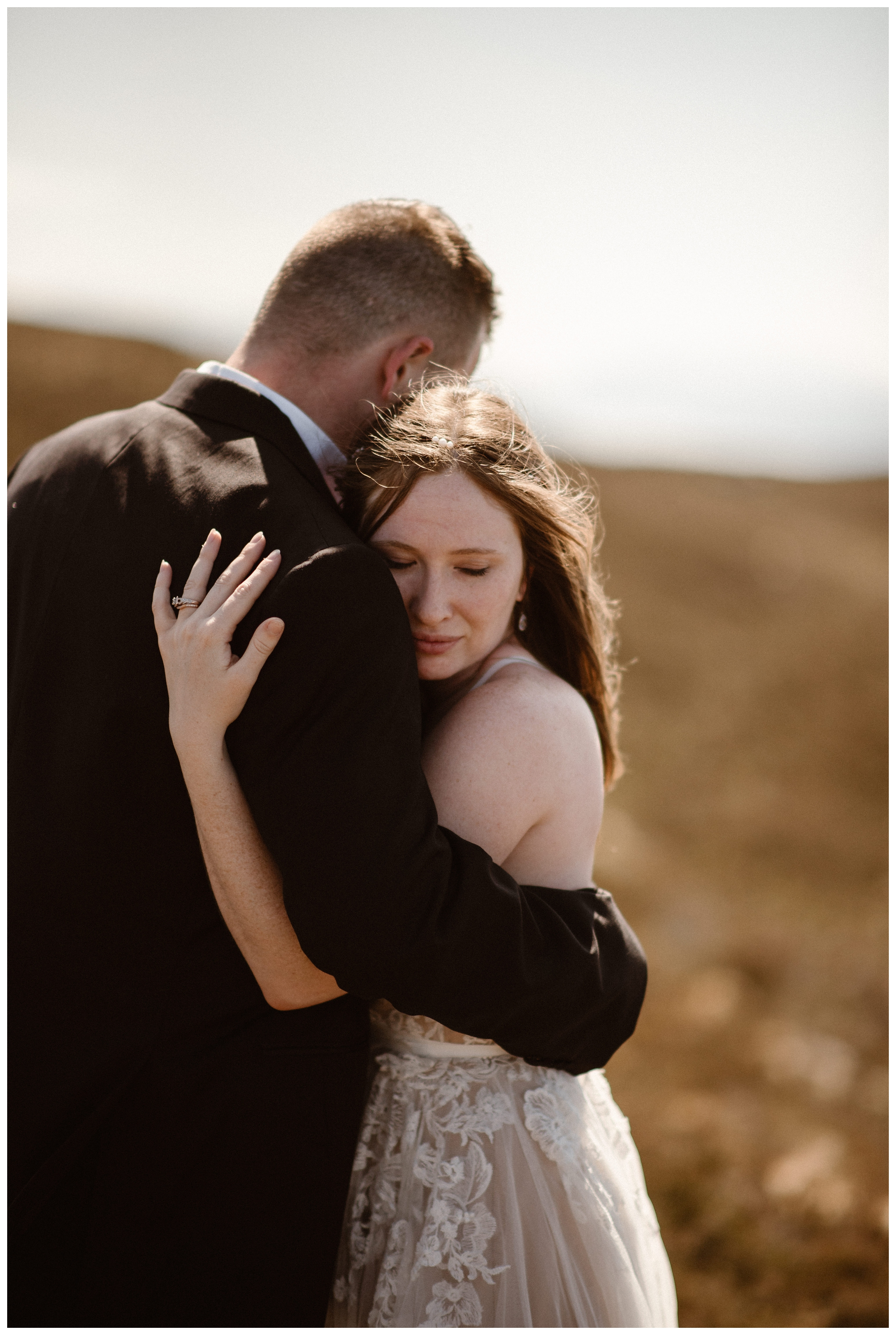 The sun was unusually bright in Scotland for Elissa and Daniel's destination elopement day after photos which we took on the shores of Loch Ness. Photo by Maddie Mae, Adventure Instead.