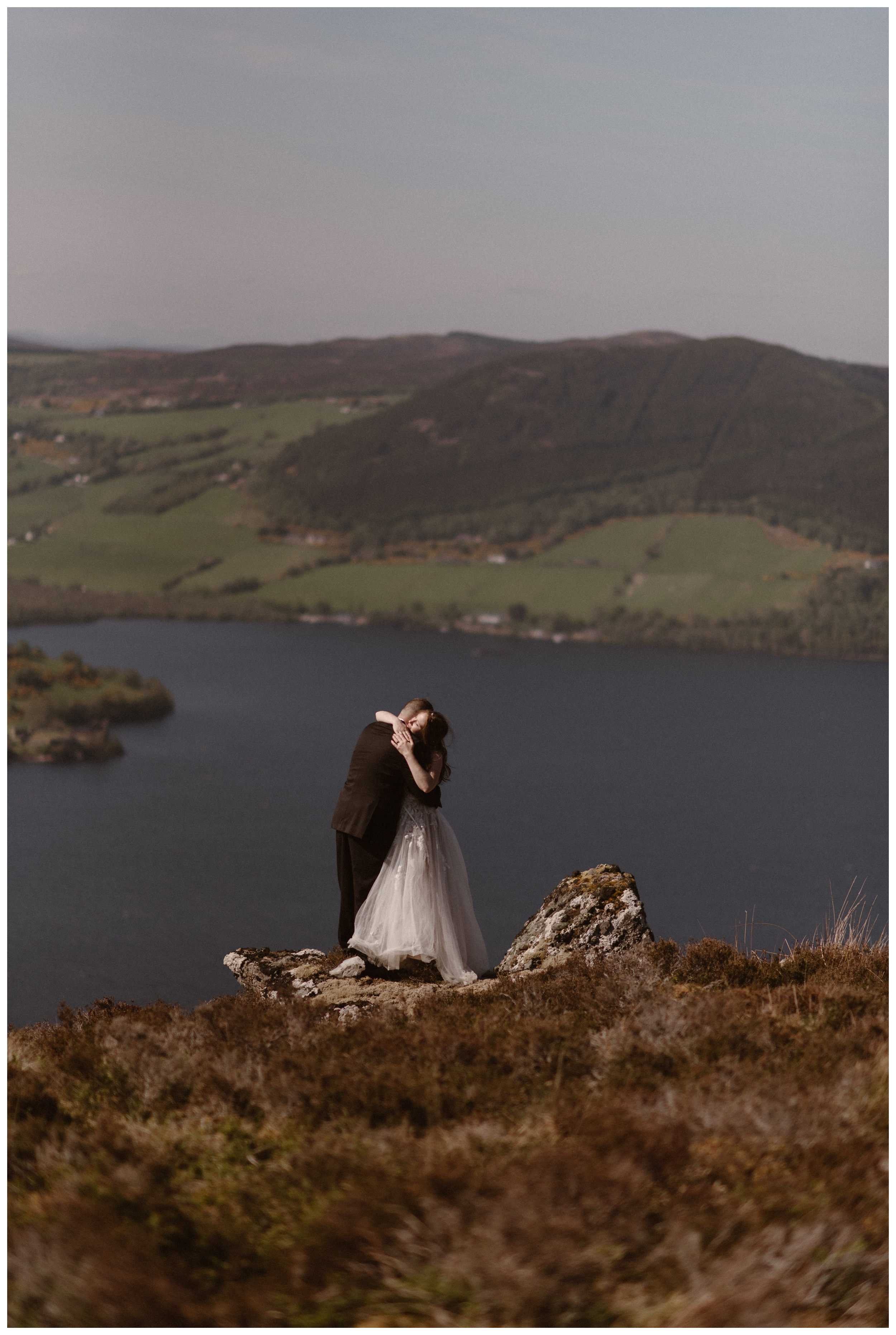 We explored the shores of Loch Ness in Scotland and could see the ruins of Urquhart Castle, a 16th century fortress in the Scottish Highlands following Elissa and Daniel's destination wedding elopement. Photo by Maddie Mae, Adventure Instead.