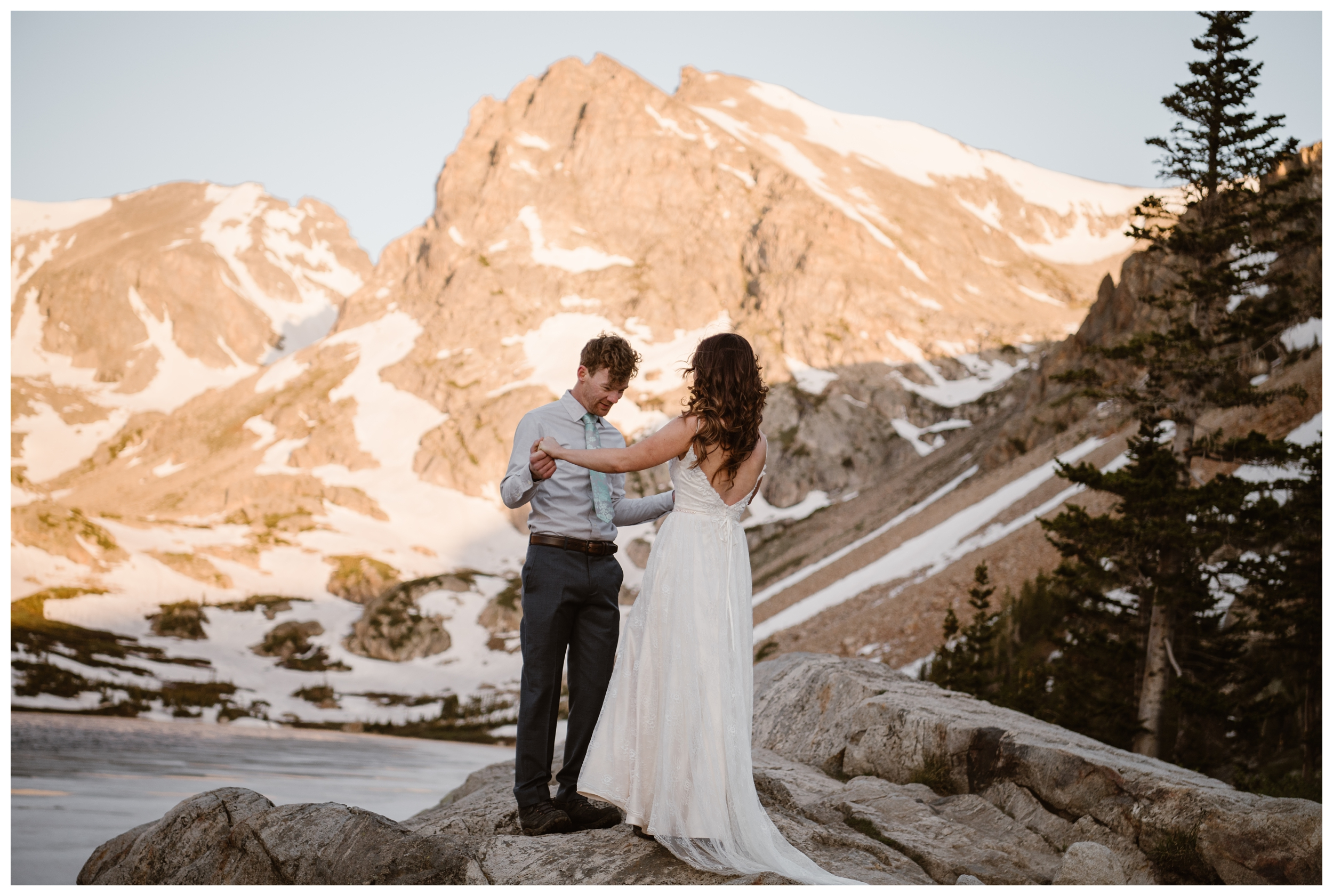It's possible to have a first look ceremony during your adventure hiking elopement. Karen and Matt brought their wedding clothes up the mountain to Lake Isabelle on their backs. Photo by Adventure Instead, Maddie Mae.