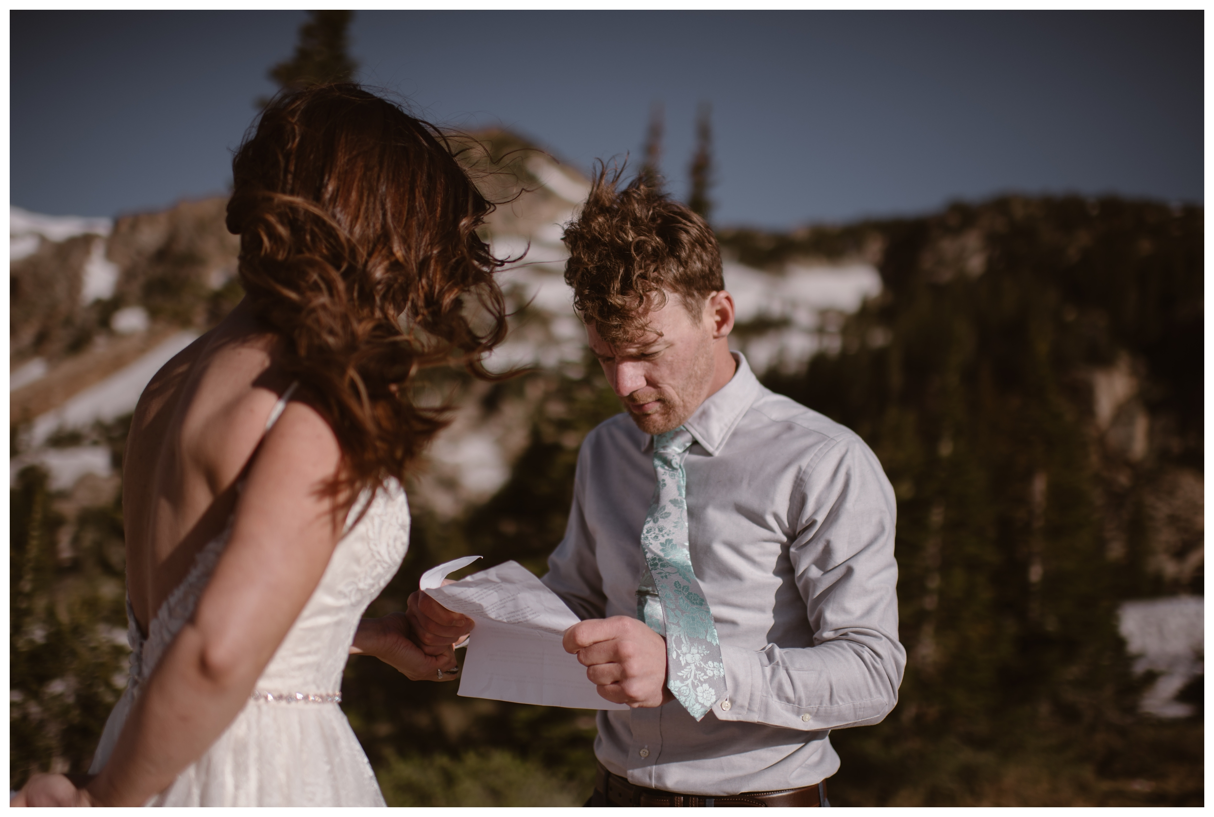 The wind blows at the top of Lake Isabelle, above Brainard Lake, outside Nederland, Colorado for Karen and Matt's high alpine lake adventure elopement ceremony. Photo by Adventure Instead, Maddie Mae.