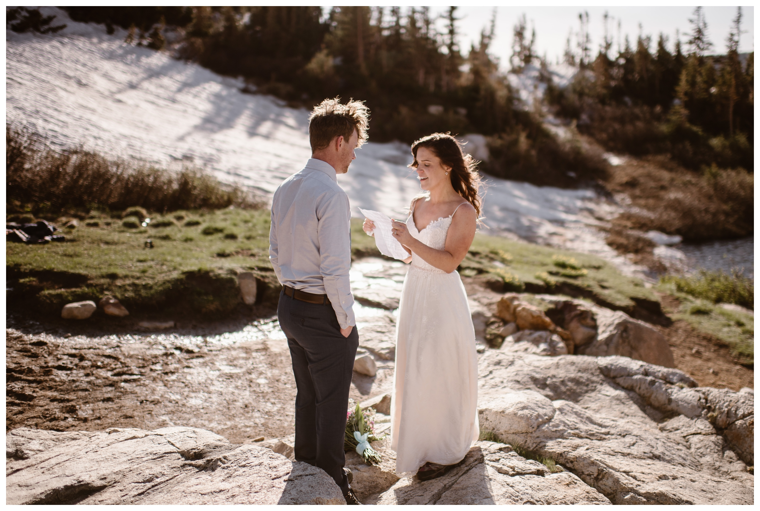 As the sun starts to rise above Lake Isabelle in Nederland, Colorado, Karen and Matt read their vows to each other during their private self solemnizing adventure elopement ceremony. Photo by Adventure Instead, Maddie Mae.