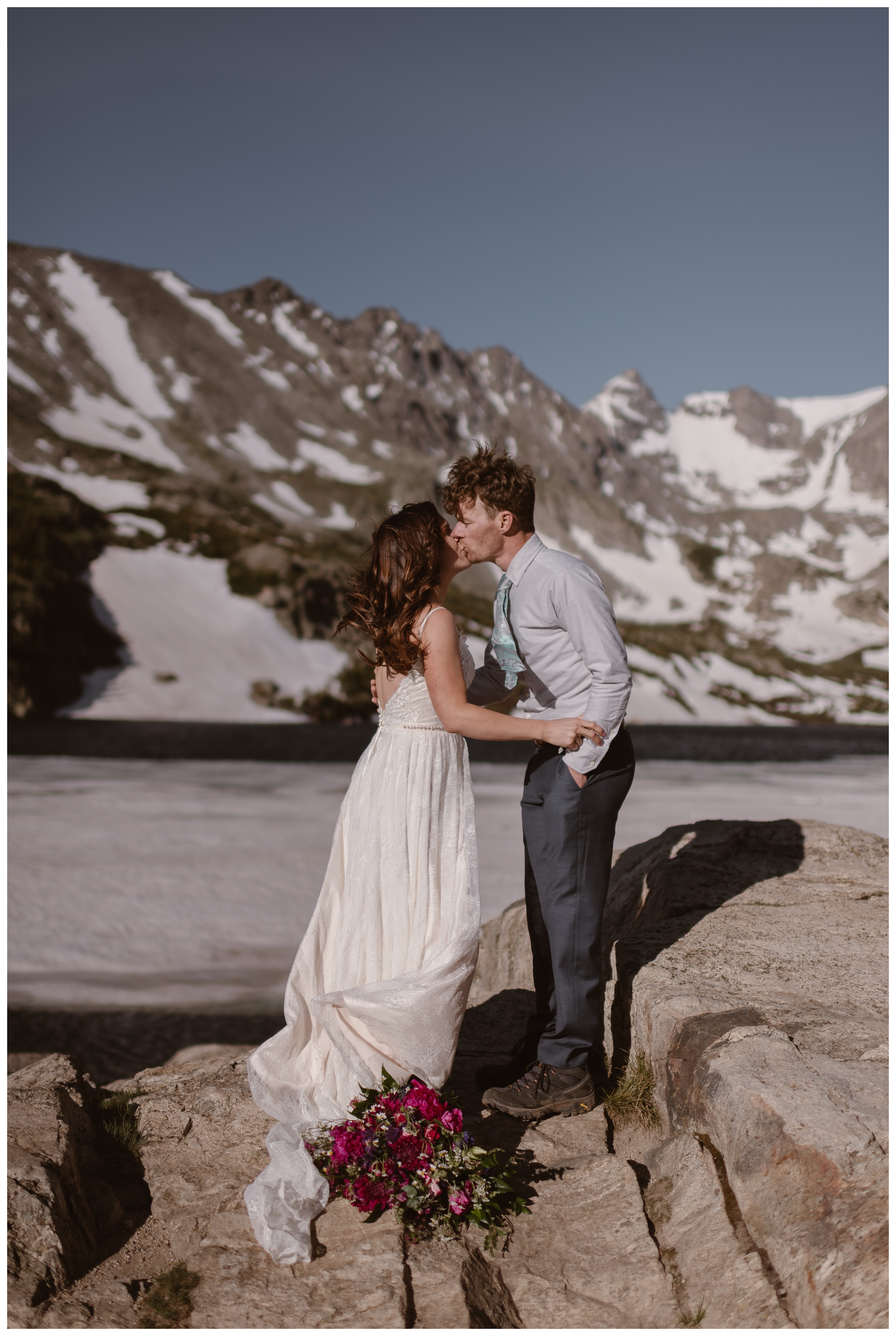 Karen and Matt seal their high alpine lake elopement with a kiss after they hiked to the top of Lake Isabelle outside Boulder, Colorado. Photo by Adventure Instead, Maddie Mae.