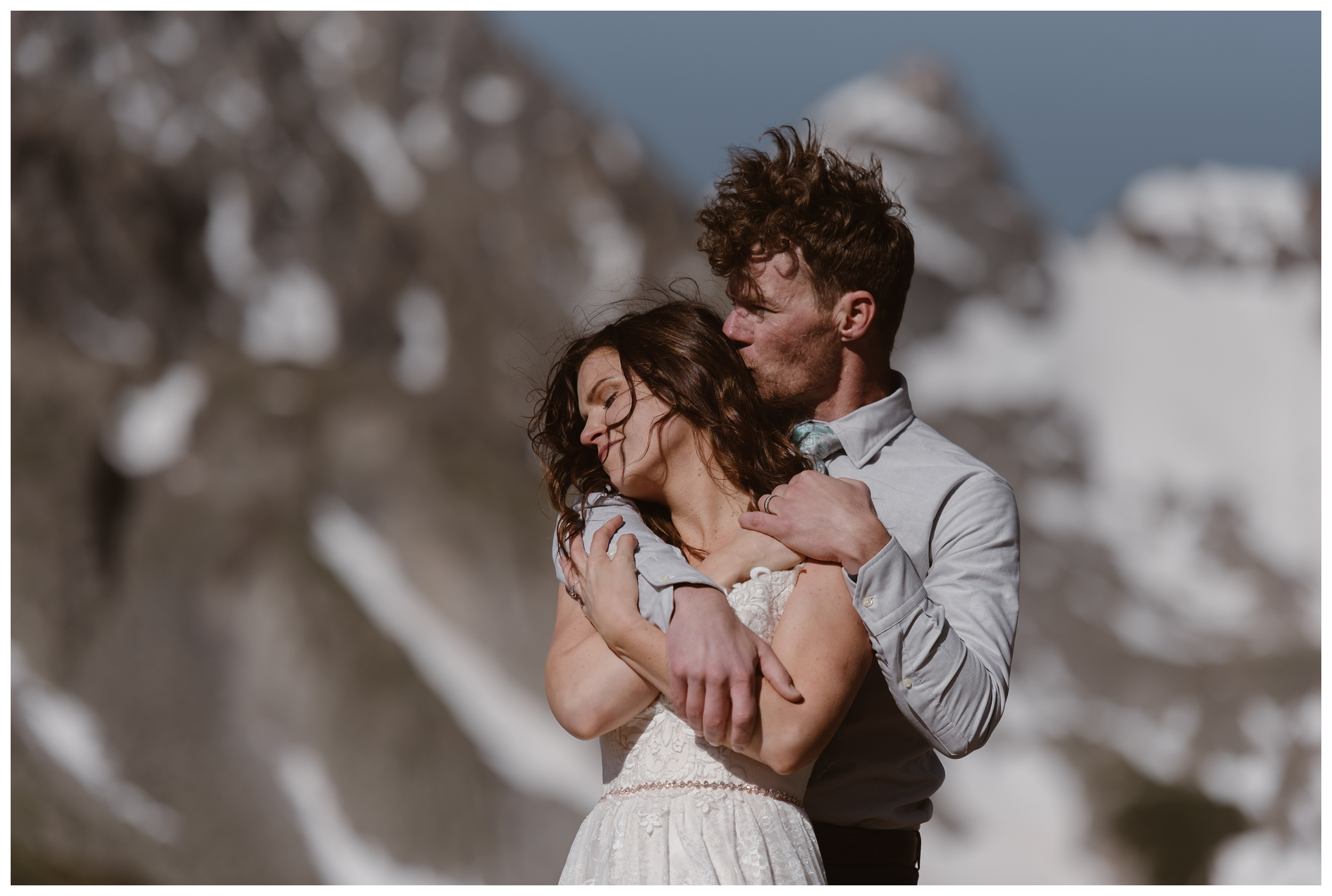 Karen and Matt embrace at the top of Lake Isabelle following their adventure elopement ceremony. Photo by Adventure Instead, Maddie Mae.