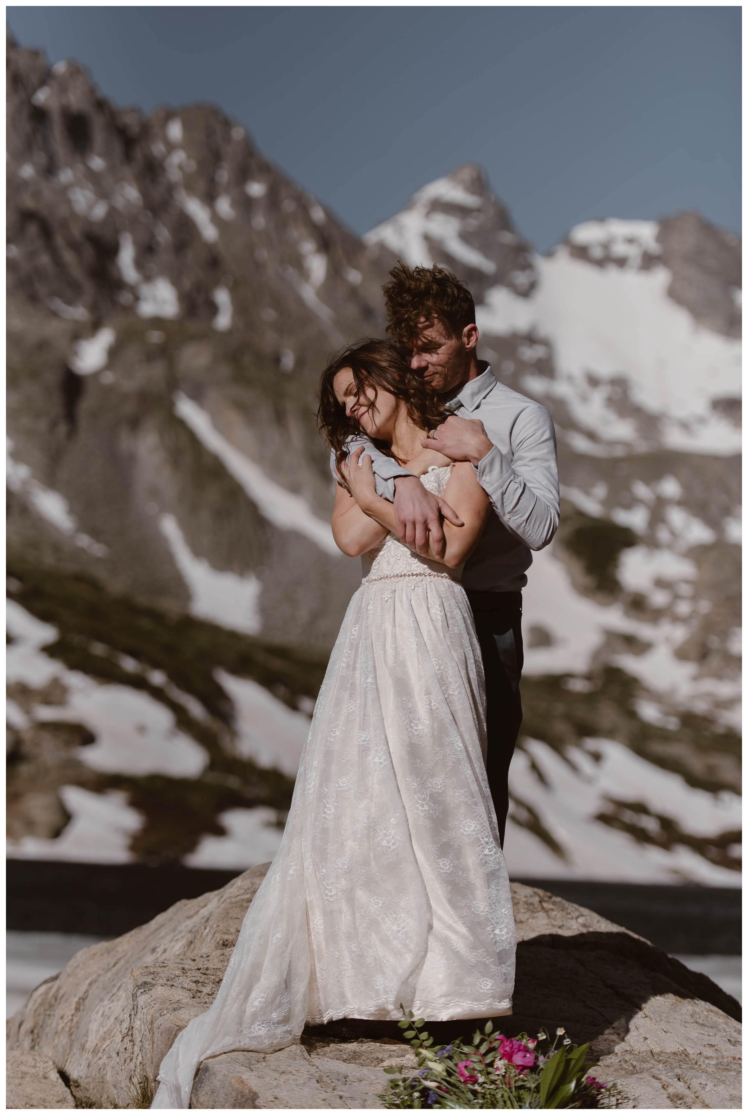 Karen and Matt hiked to the top of Lake Isabelle, outside Nederland, Colorado so they could have a high alpine lake elopement ceremony. Photo by Adventure Instead, Maddie Mae.