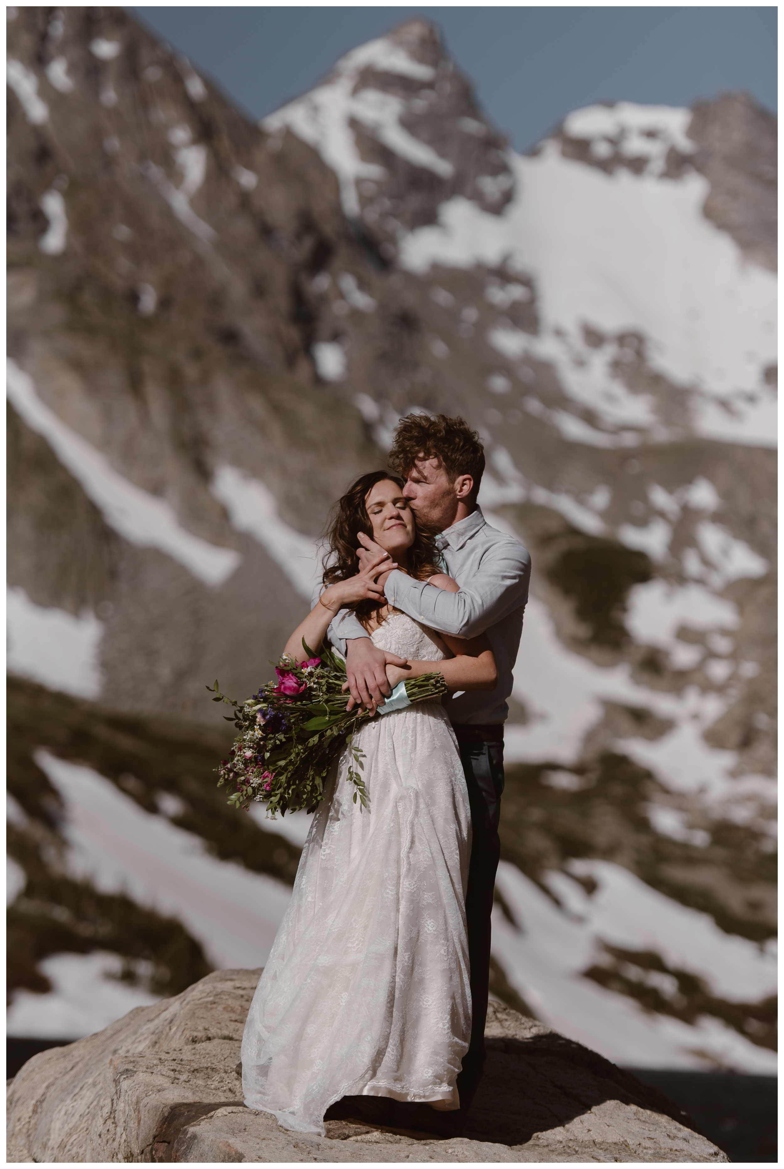 Although their first location of Rocky Mountain National Park didn't work for a high alpine lake elopement ceremony, Karen and Matt were able to use Lake Isabelle outside Nederland, Colorado as a back up. Photo by Adventure Instead, Maddie Mae.
