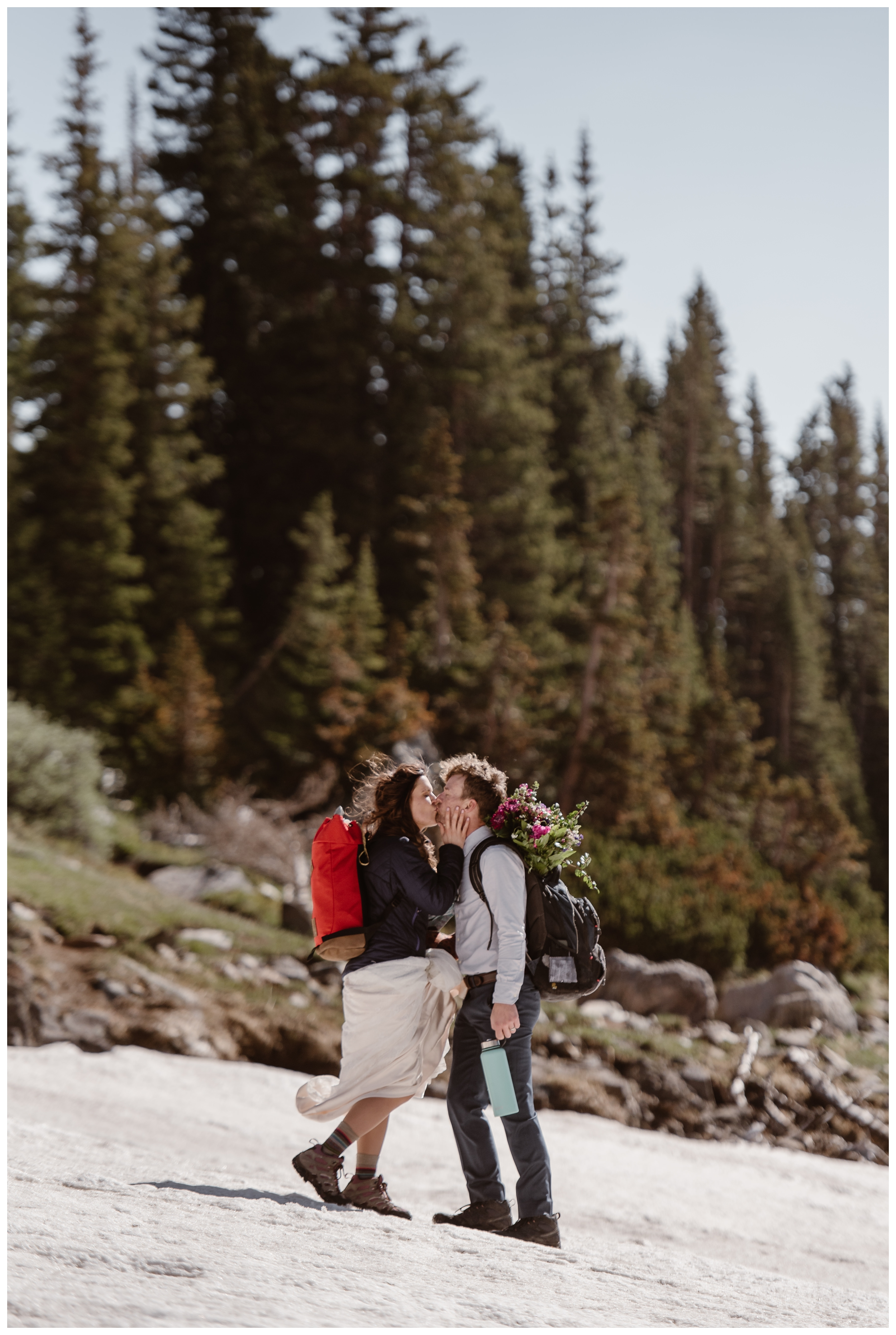 Karen and Matt begin to hike back down the trail at Lake Isabelle following their high alpine lake elopement ceremony in Nederland, Colorado. Photo by Adventure Instead, Maddie Mae.