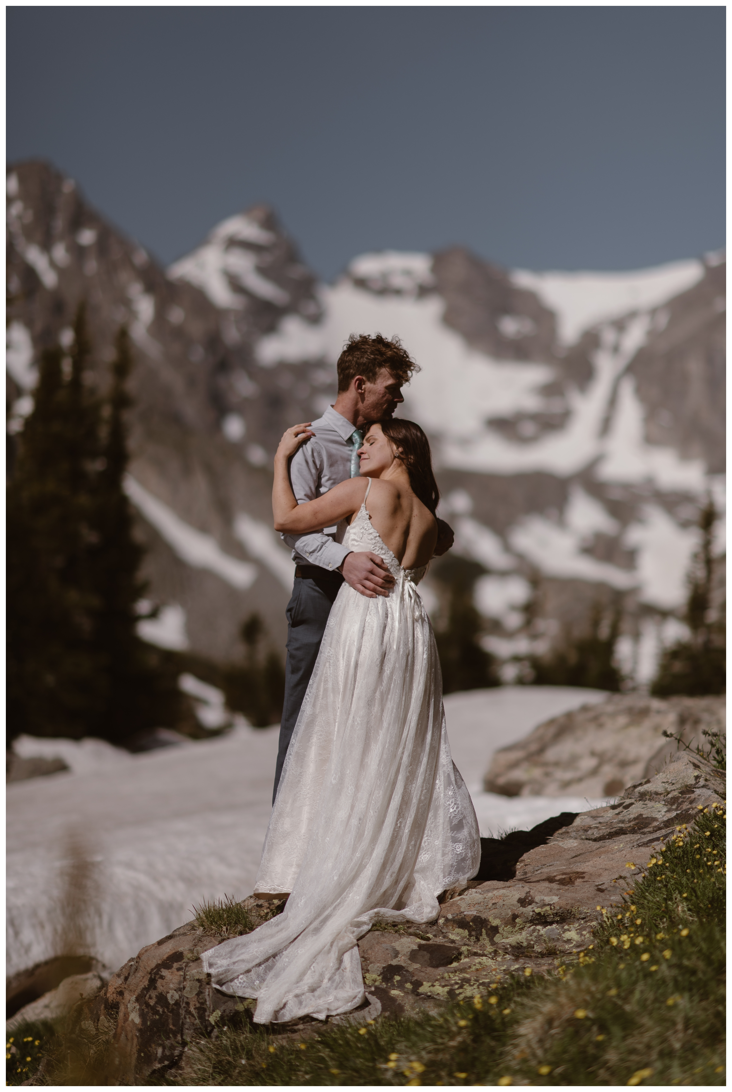 Karen and Matt embrace after they said their vows during a private self solemnizing elopement ceremony at Lake Isabelle, in Nederland, Colorado. Photo by Adventure Instead, Maddie Mae.