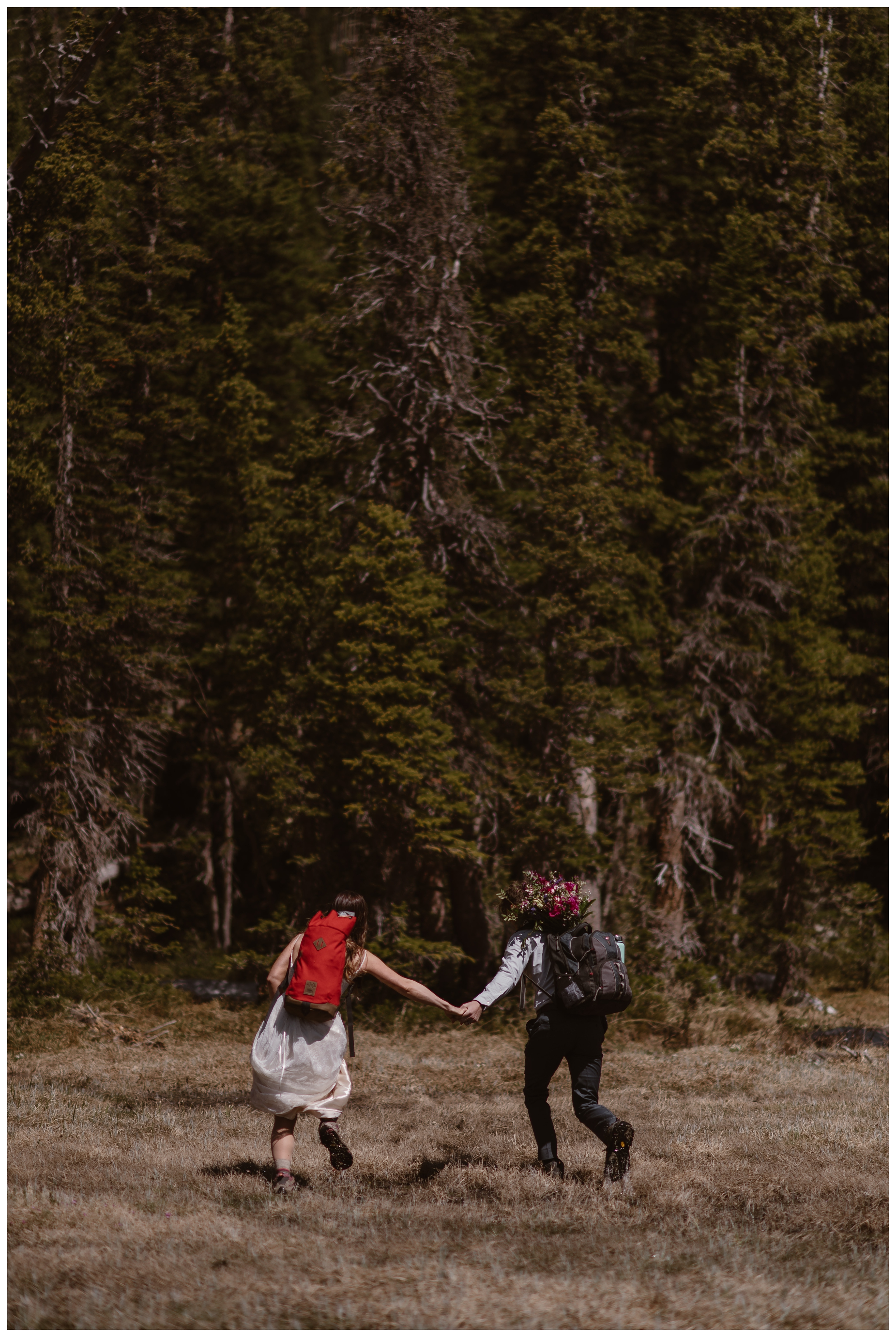 Karen and Matt begin the hike down following their high alpine adventure lake elopement ceremony in Nederland, Colorado. Photo by Adventure Instead, Maddie Mae.