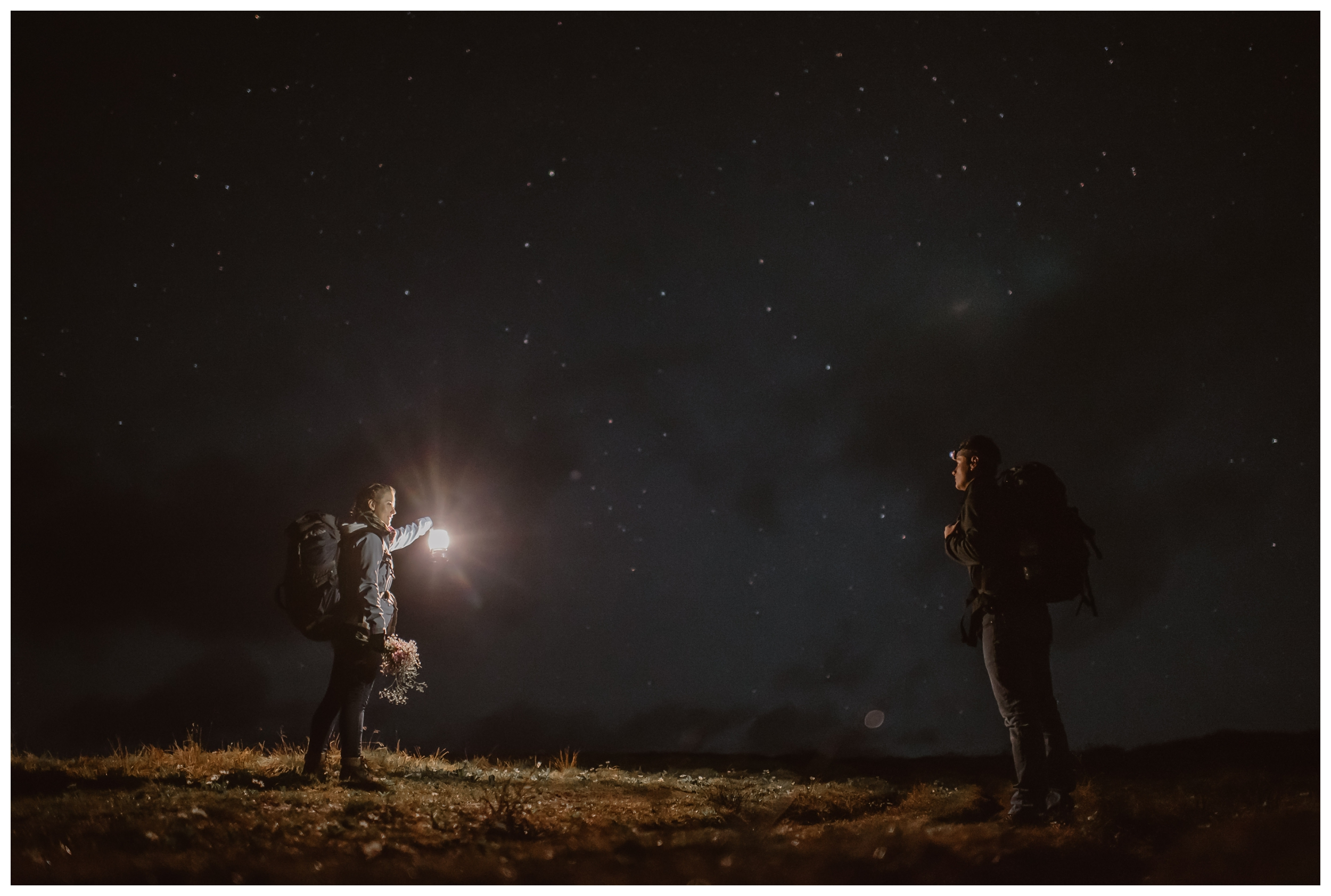 With the hike illuminated only by their headlamps and a lantern, Marcela and Vasily begin to hike near Independence Pass, hoping to summit before sunrise for their intimate elopement. Photo by Maddie Mae, Adventure Instead.
