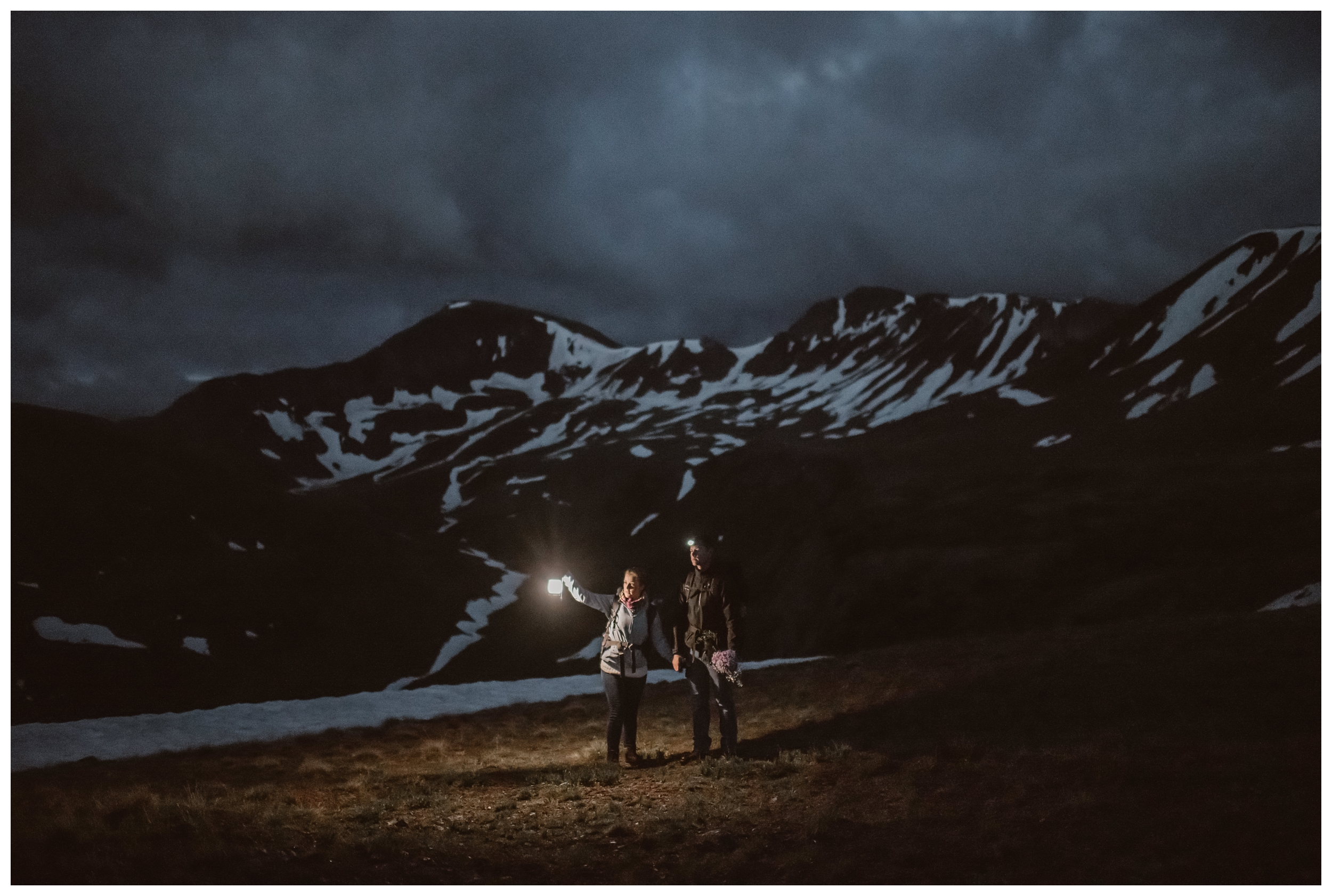Marcela and Vasily hike in the dark before sunrise, surrounded by the peaks of Independence Pass, Colorado, for their early morning self solemnizing elopement. Photo by Maddie Mae, Adventure Instead.