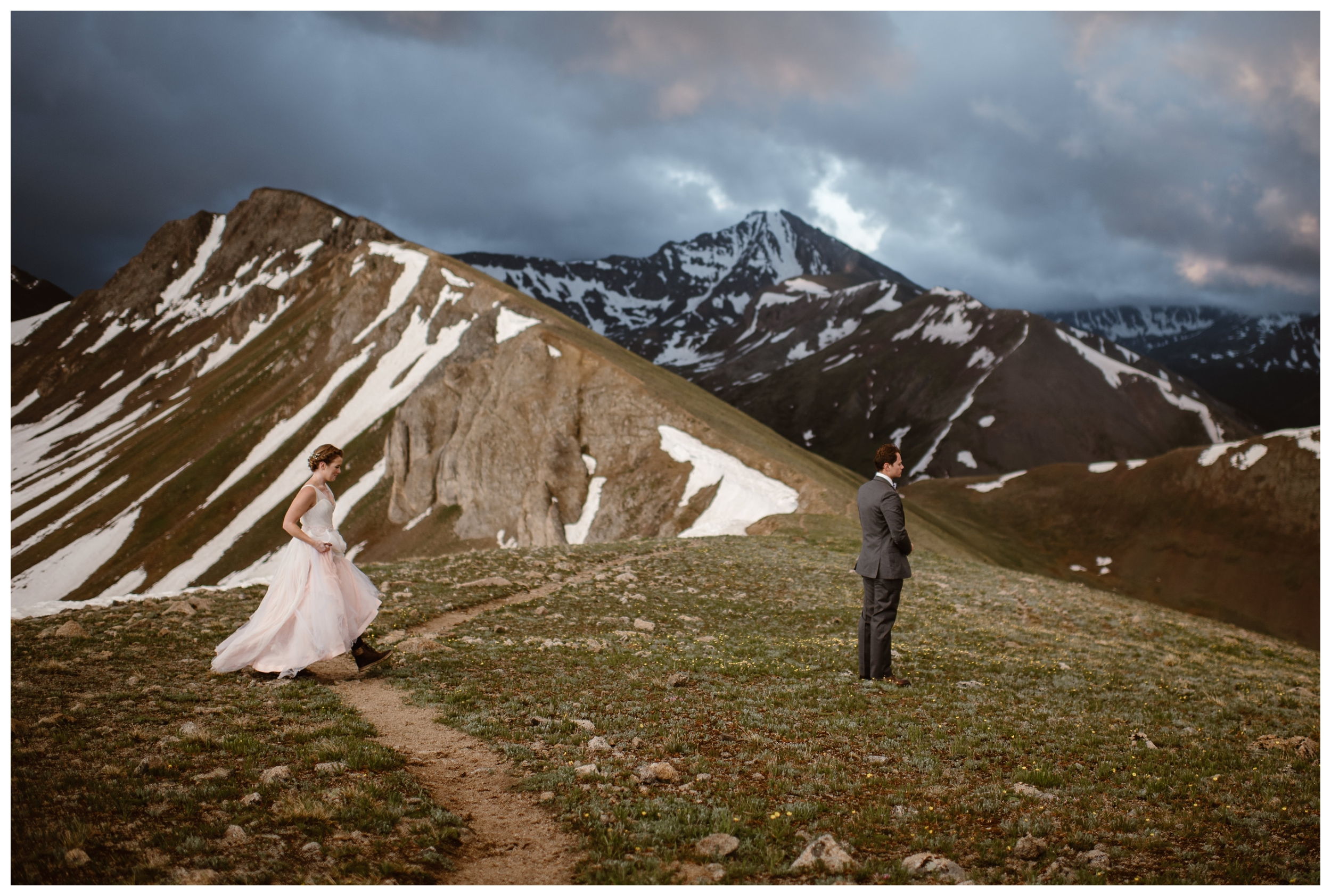 Marcela approaches Vasily for their intimate first look on top of a mountain ridge at the top of Independence Pass. Even though they had an intimate two person elopement, they were able to get ready separately and have a first look. Photo by Maddie Mae, Adventure Instead.