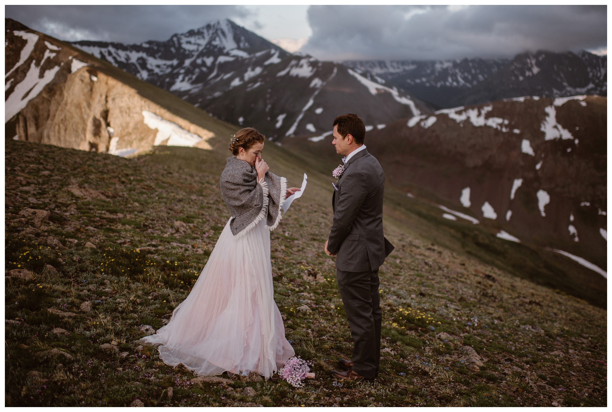 Marcela and Vasily's intimate self solemnizing wedding included them reading their own vows, while surrounded by the high, jagged peaks of the Rocky Mountains. Photo by Maddie Mae, Adventure Instead.