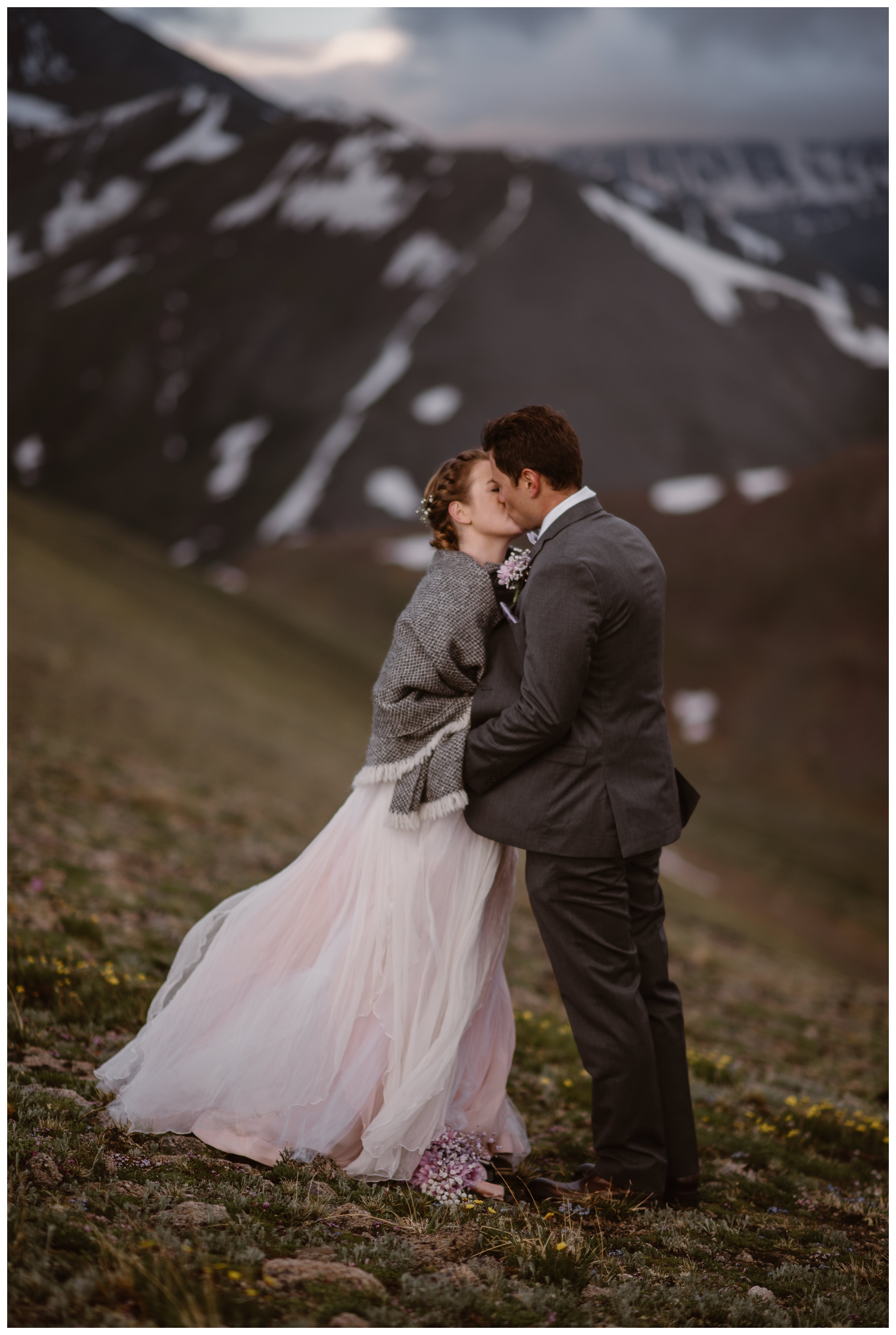 Marcela and Vasily share their first kiss as man and wife on the top of Independence Pass, following their intimate elopement ceremony. Photo by Maddie Mae, Adventure Instead.