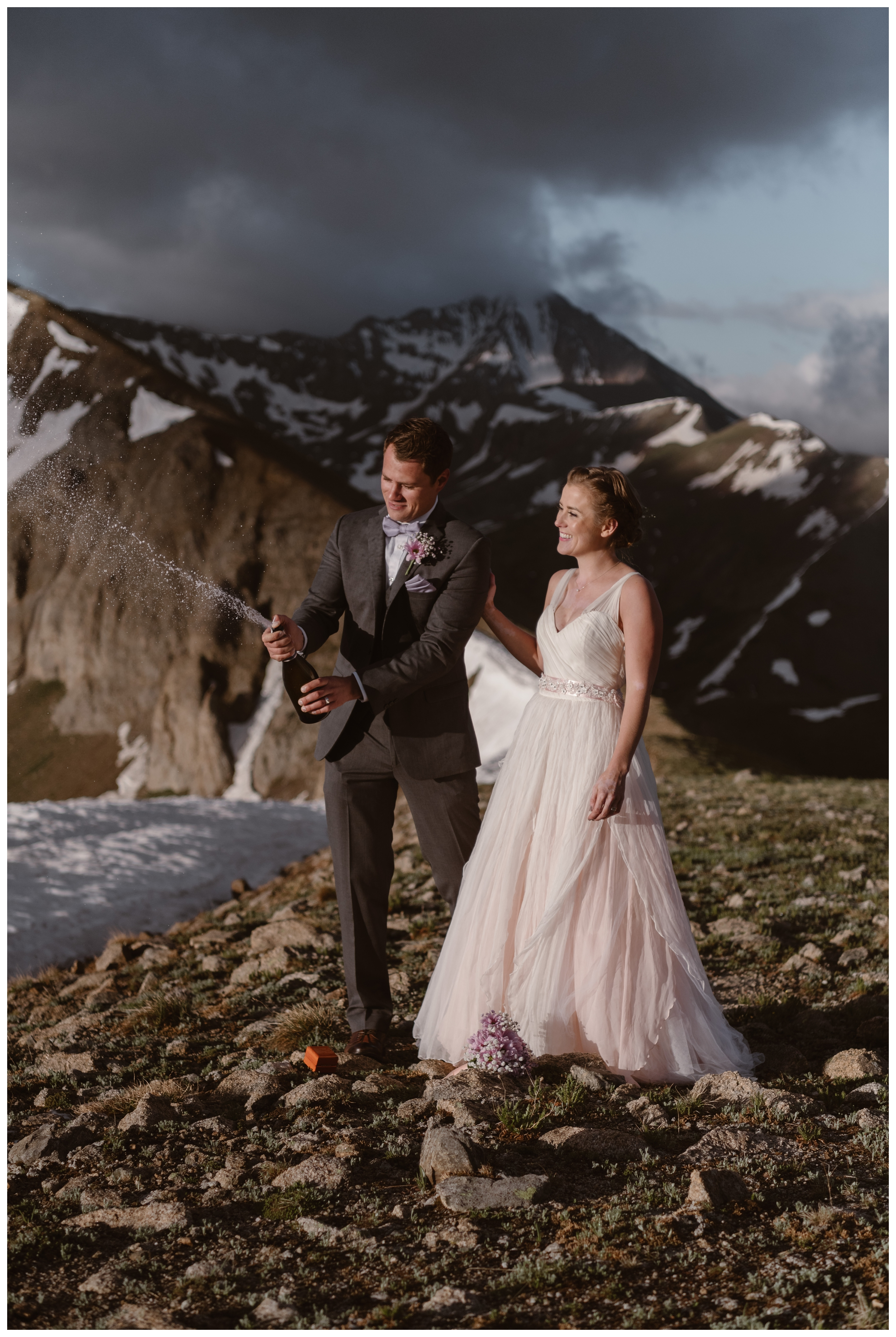 Marcela and Vasily pop open a bottle of champagne after their intimate self solemnizing ceremony that they hiked to the top of Independence Pass for. Photo by Maddie Mae, Adventure Instead.