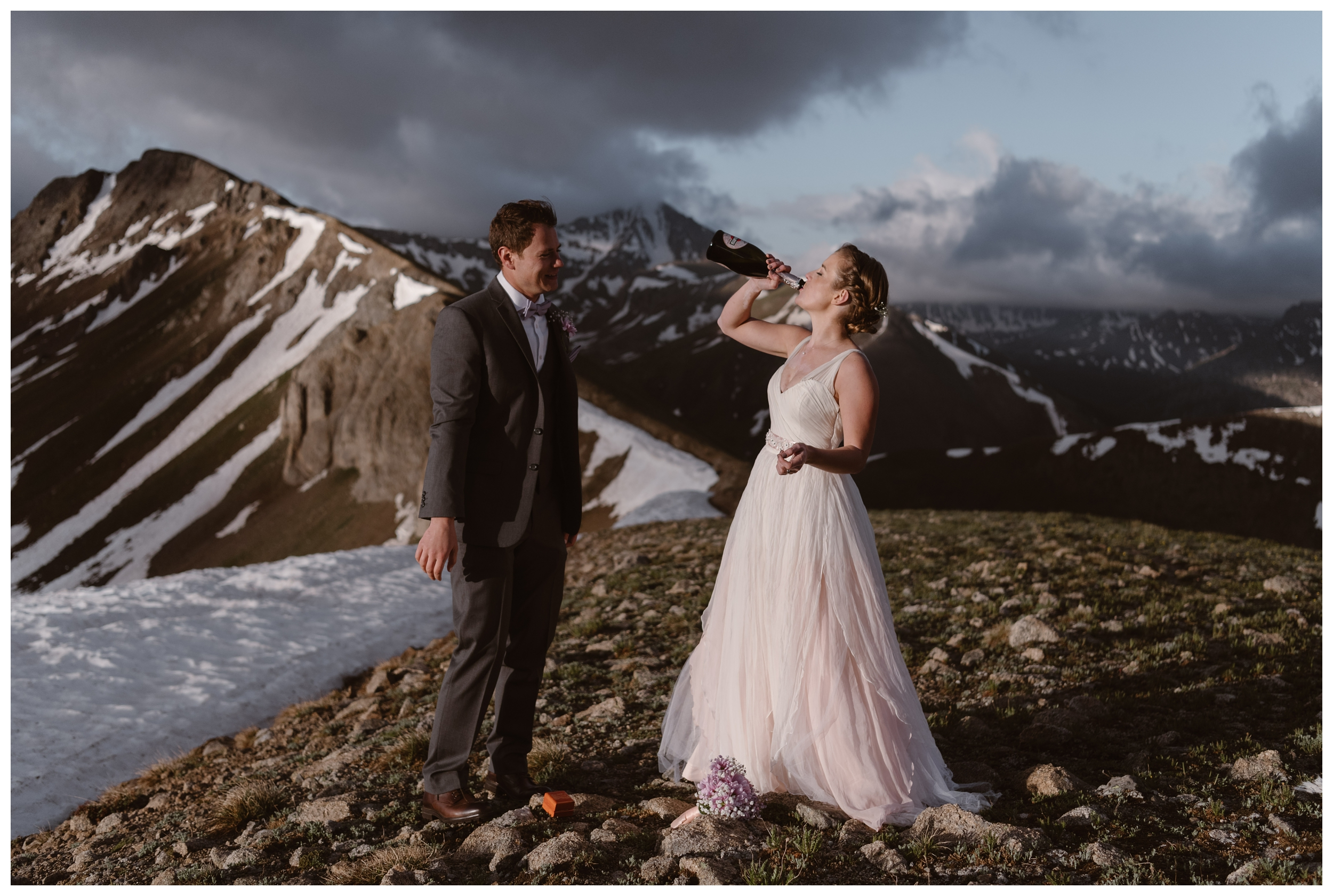 To celebrate their elopement ceremony, Marcela and Vasily opened a bottle of champagne and drank it while surrounded by the jagged peaks of the Sawatch Range of the Rocky Mountains. Photo by Maddie Mae, Adventure Instead.