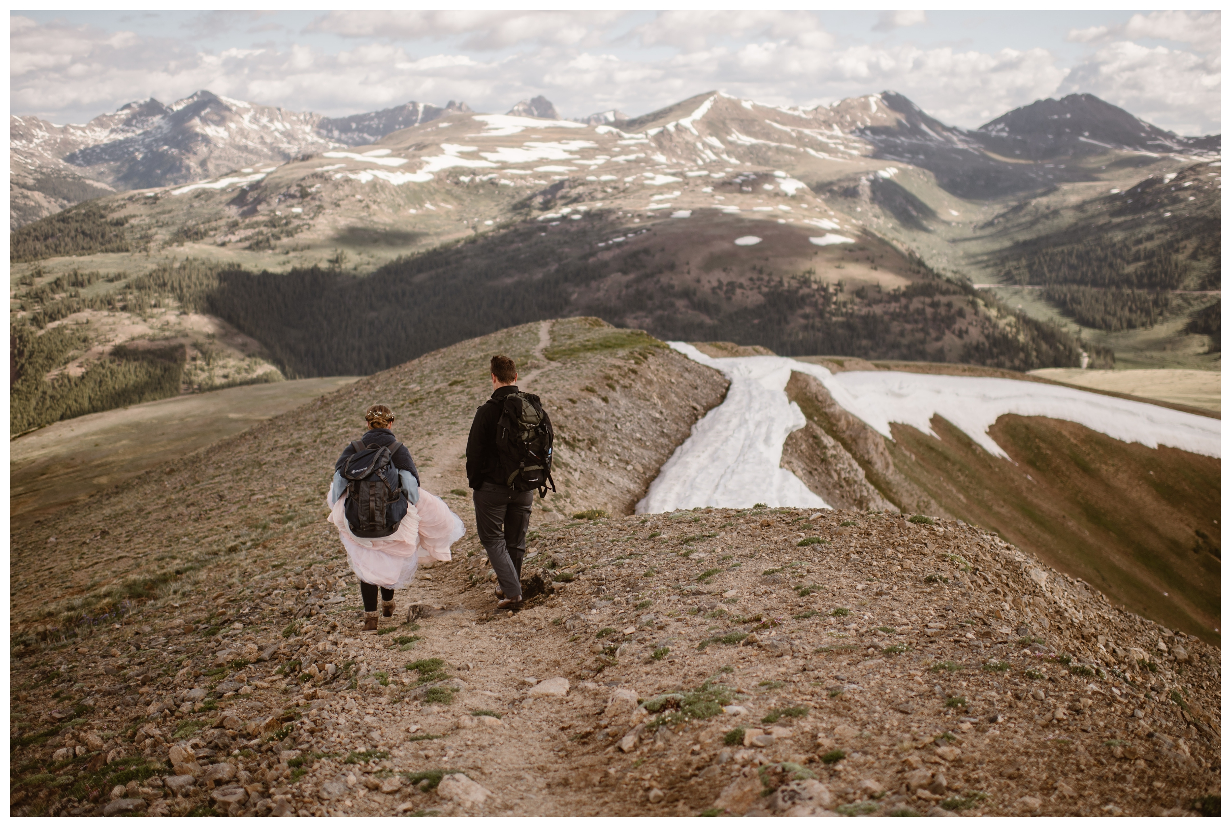 Marcela and Vasily hike down following their adventure elopement ceremony on the top of Independence Pass, outside Aspen Colorado. Photo by Maddie Mae, Adventure Instead.