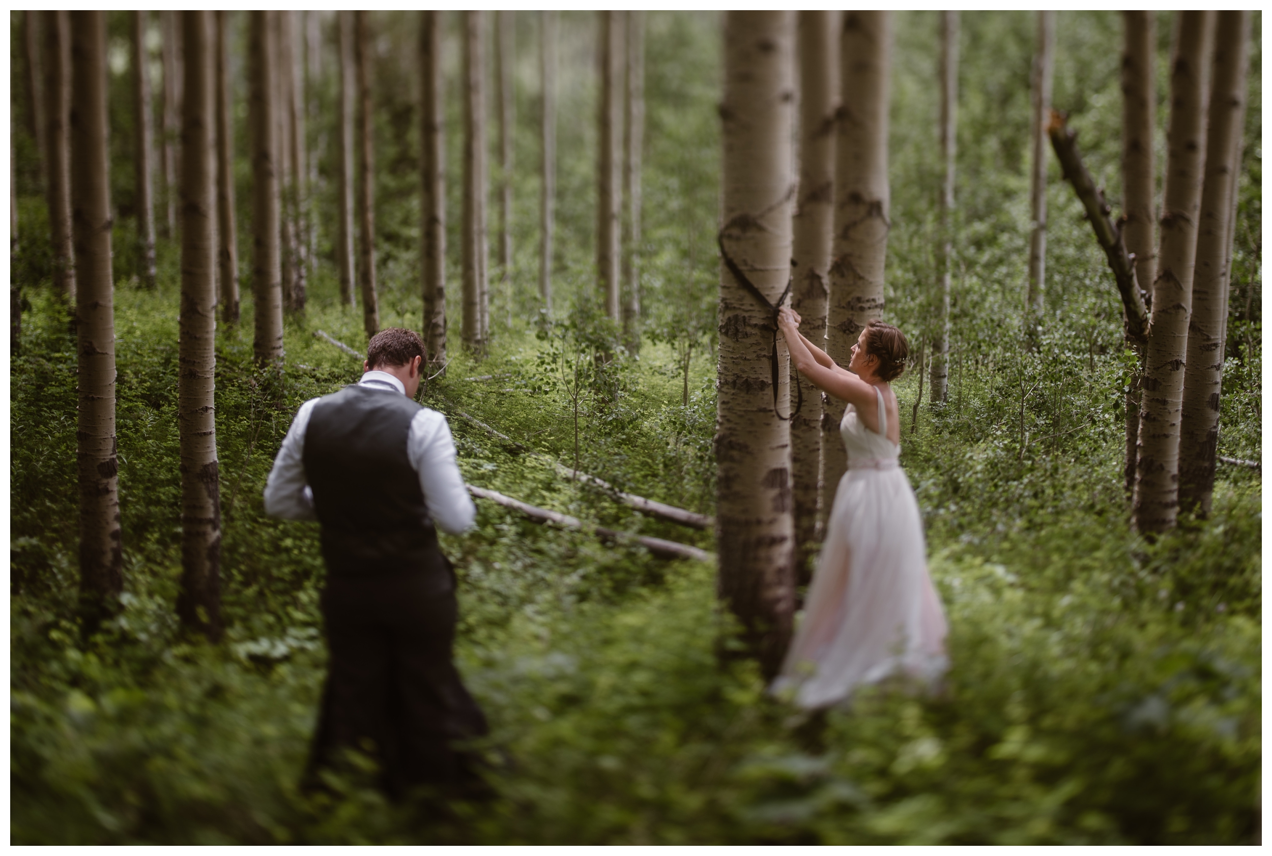 In old growth forests outside Aspen, Colorado's Maroon Bells, Marcela and Vasily hang a pack hammock following their outdoor elopement ceremony. Photo by Maddie Mae, Adventure Instead.