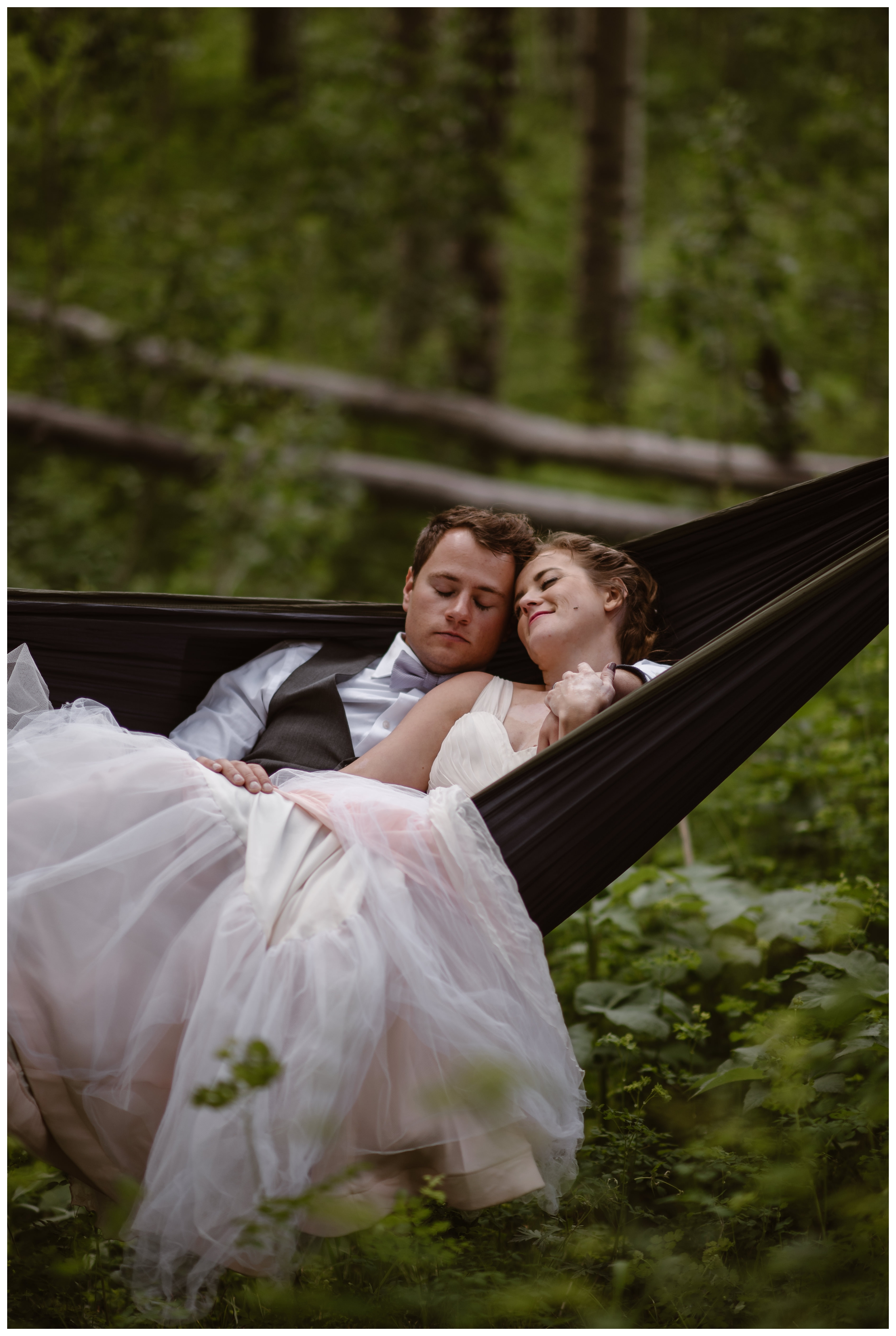Following their hiking elopement ceremony at the top of Independence Pass, Marcela and Vasily cuddle in a pack hammock surrounded by old growth aspen trees outside the Maroon Bells. Photo by Maddie Mae, Adventure Instead.