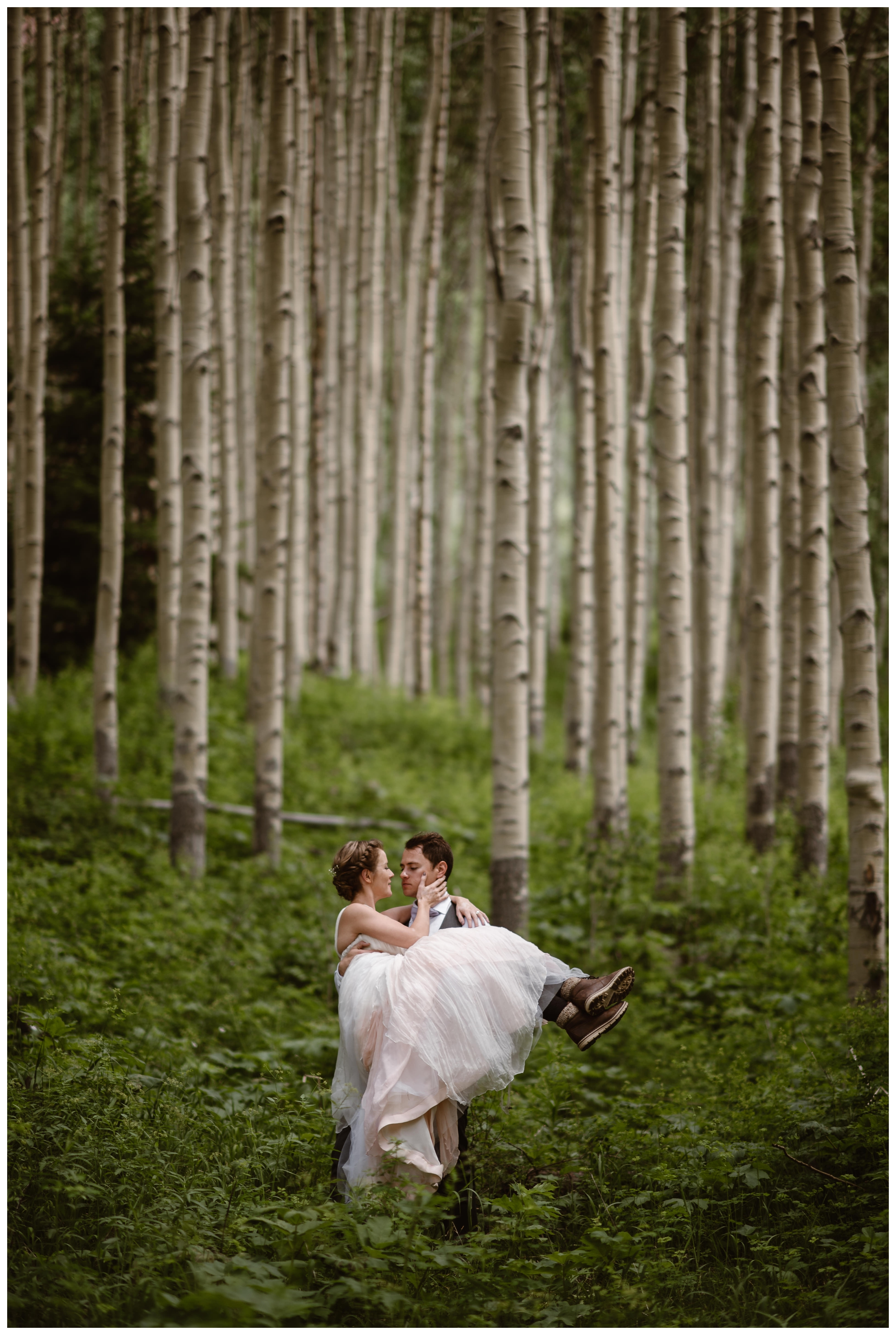 Marcela and Vasily embrace while surrounded by old aspen trees following their elopement ceremony at the top of Independence Pass outside Aspen, Coloardo. Photo by Maddie Mae, Adventure Instead.