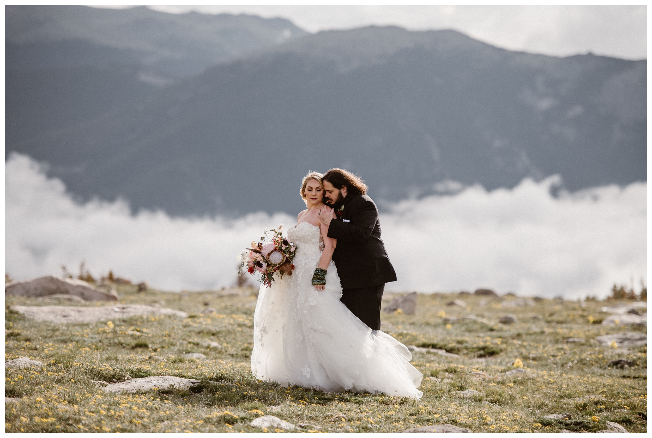 The clouds roll in for an impressive display of cloud inversion at high altitude during Alicia and Zach's couples portraits before their intimate elopement ceremony at Rocky Mountain National Park. Photo by Adventure Instead, Maddie Mae.