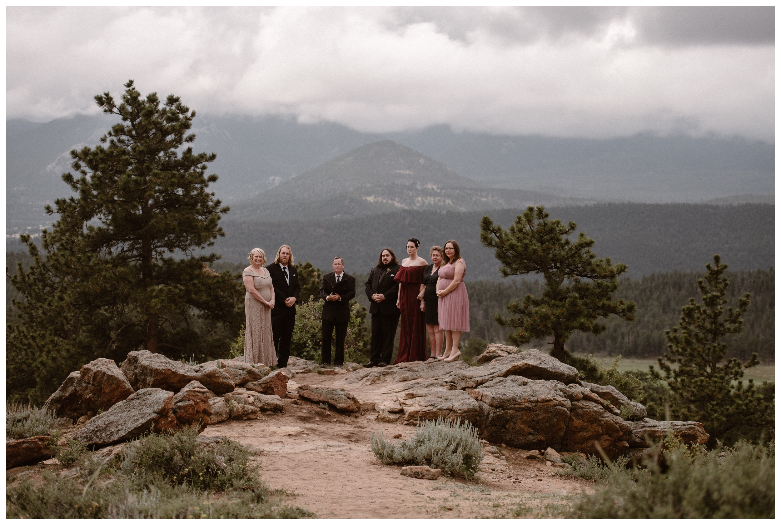 Surrounded by close friends and family, Zach waits for his bride to walk down the aisle for their intimate elopement ceremony inside Rocky Mountain National Park, Estes Park, Colorado. Photo by Adventure Instead, Maddie Mae.