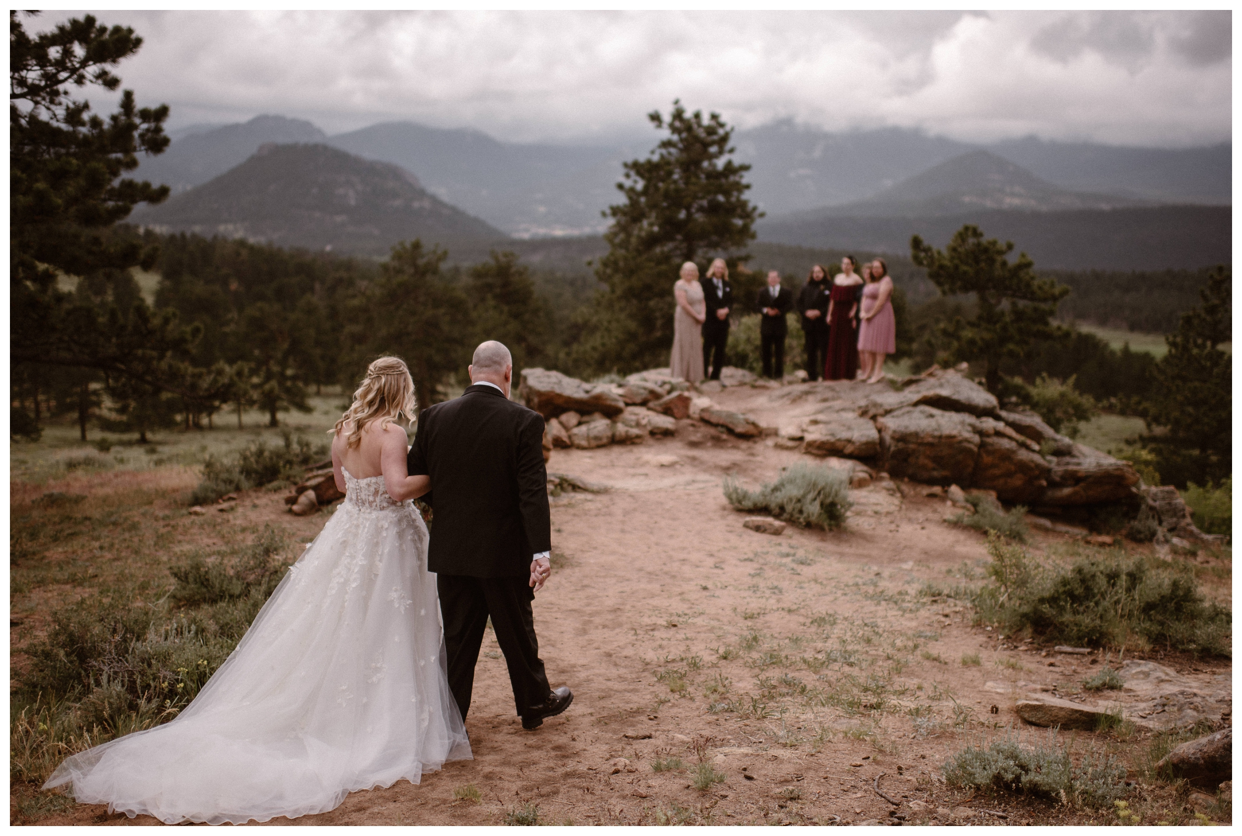 Alicia walks down the aisle towards close family and friends for her intimate elopement ceremony inside Rocky Mountain National Park in Estes Park, Colorado. Photo by Adventure Instead, Maddie Mae.