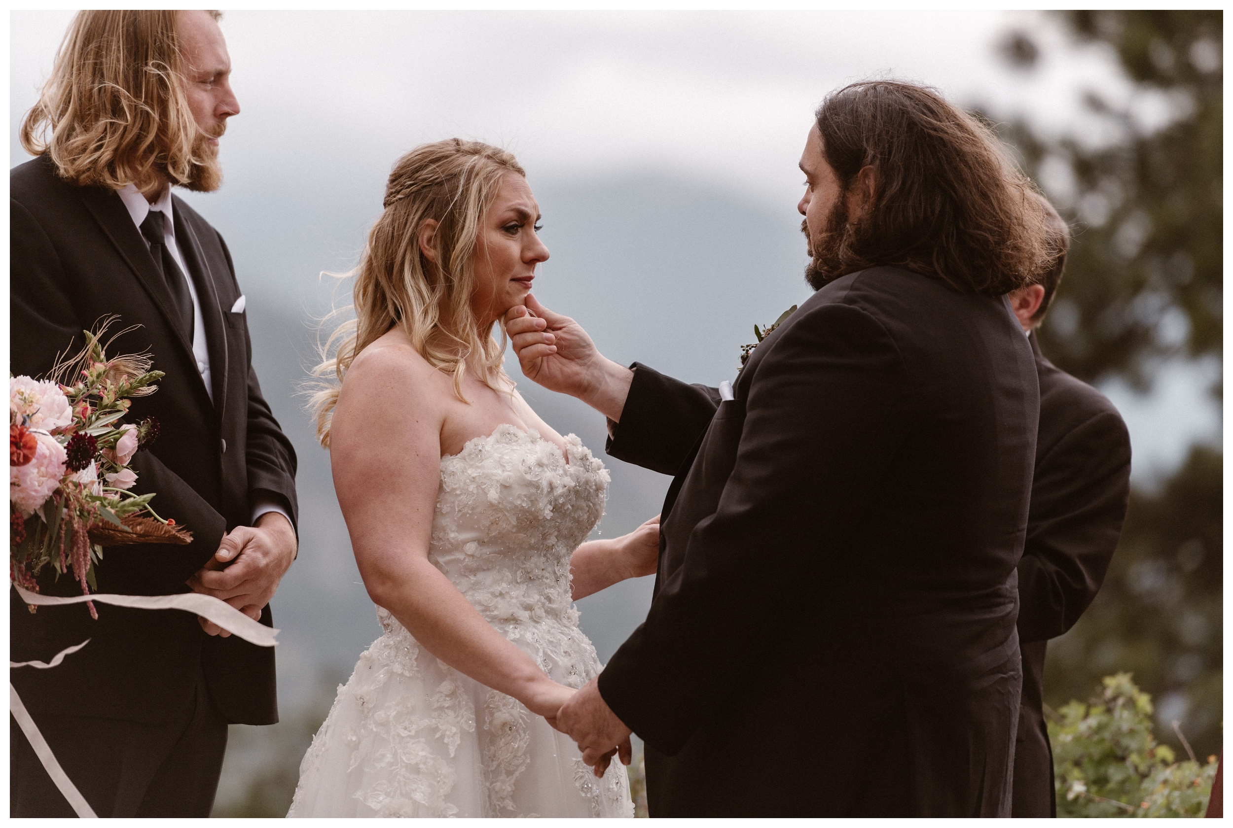 A tearful and emotional moment during Alicia and Zach's intimate elopement ceremony at Rocky Mountain National Park in Estes Park, Colorado. Photo by Adventure Instead, Maddie Mae.