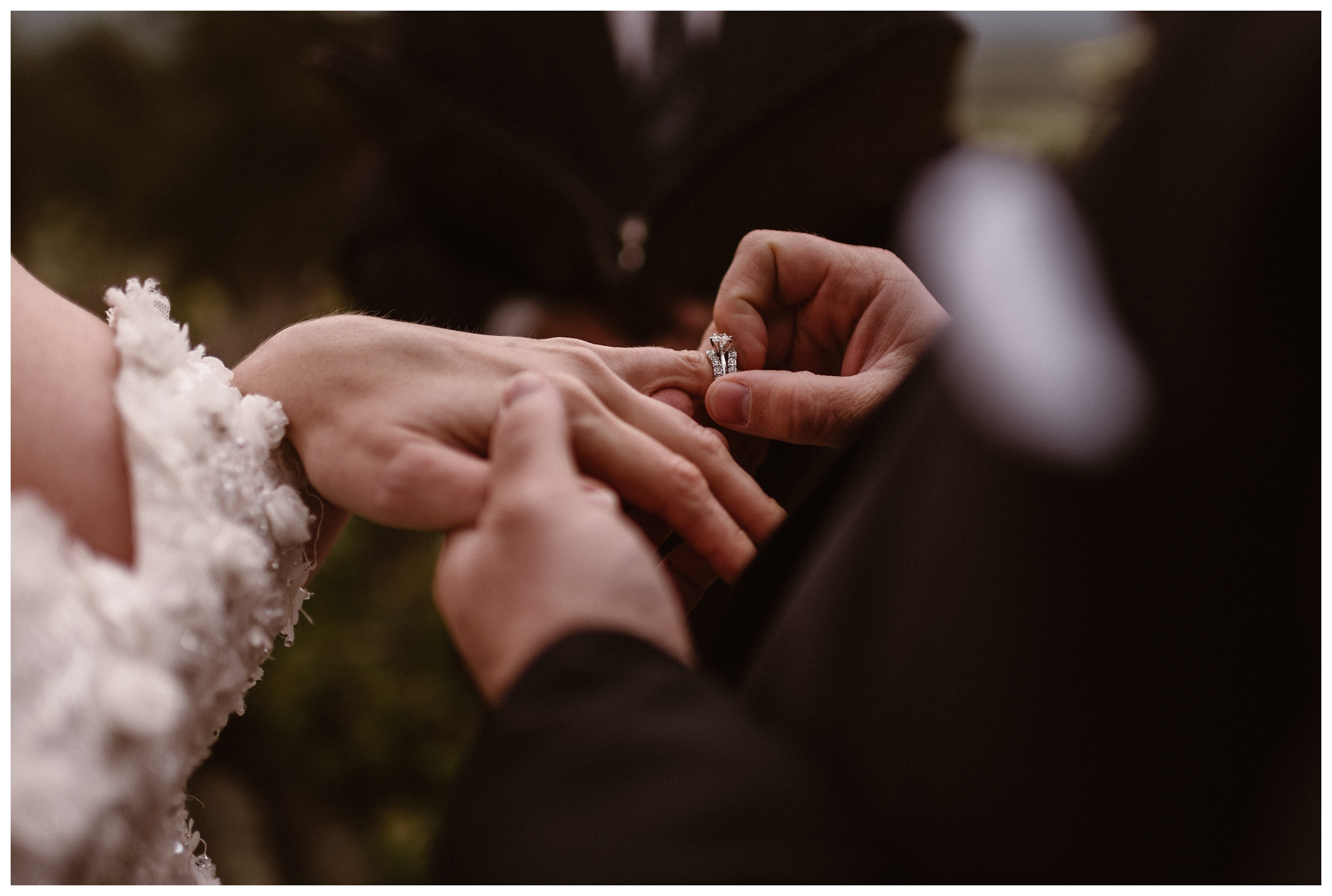 Zach places the wedding band on Alicia's finger during their intimate elopement ceremony at Rocky Mountain National Park. Photo by Adventure Instead, Maddie Mae.