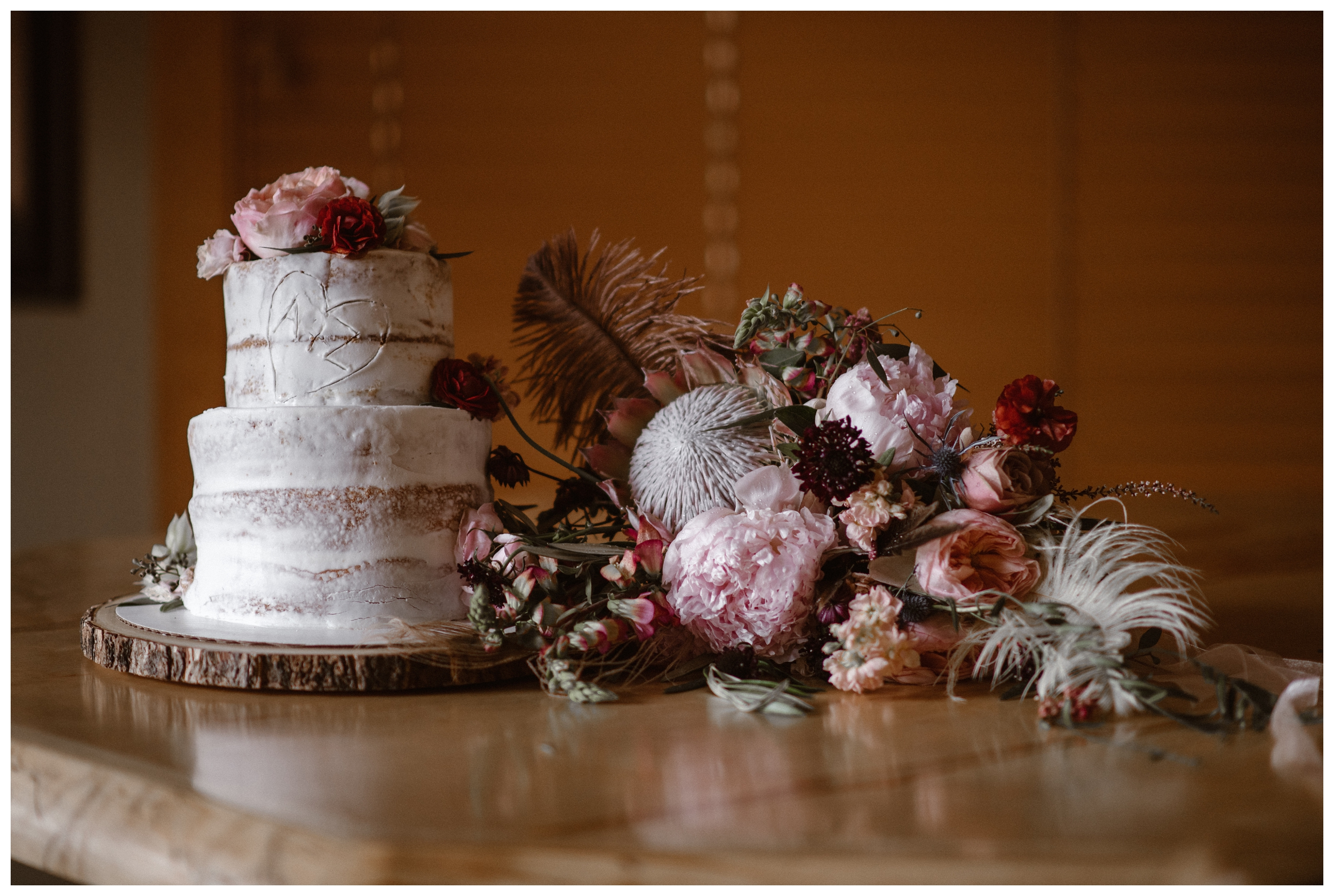 Alicia's bridal bouquet rests next to the wedding cake that mimics the Rocky Mountains plentiful aspen trees following their elopement ceremony at Rocky Mountain National Park in Estes Park, Colorado. Photo by Adventure Instead, Maddie Mae.